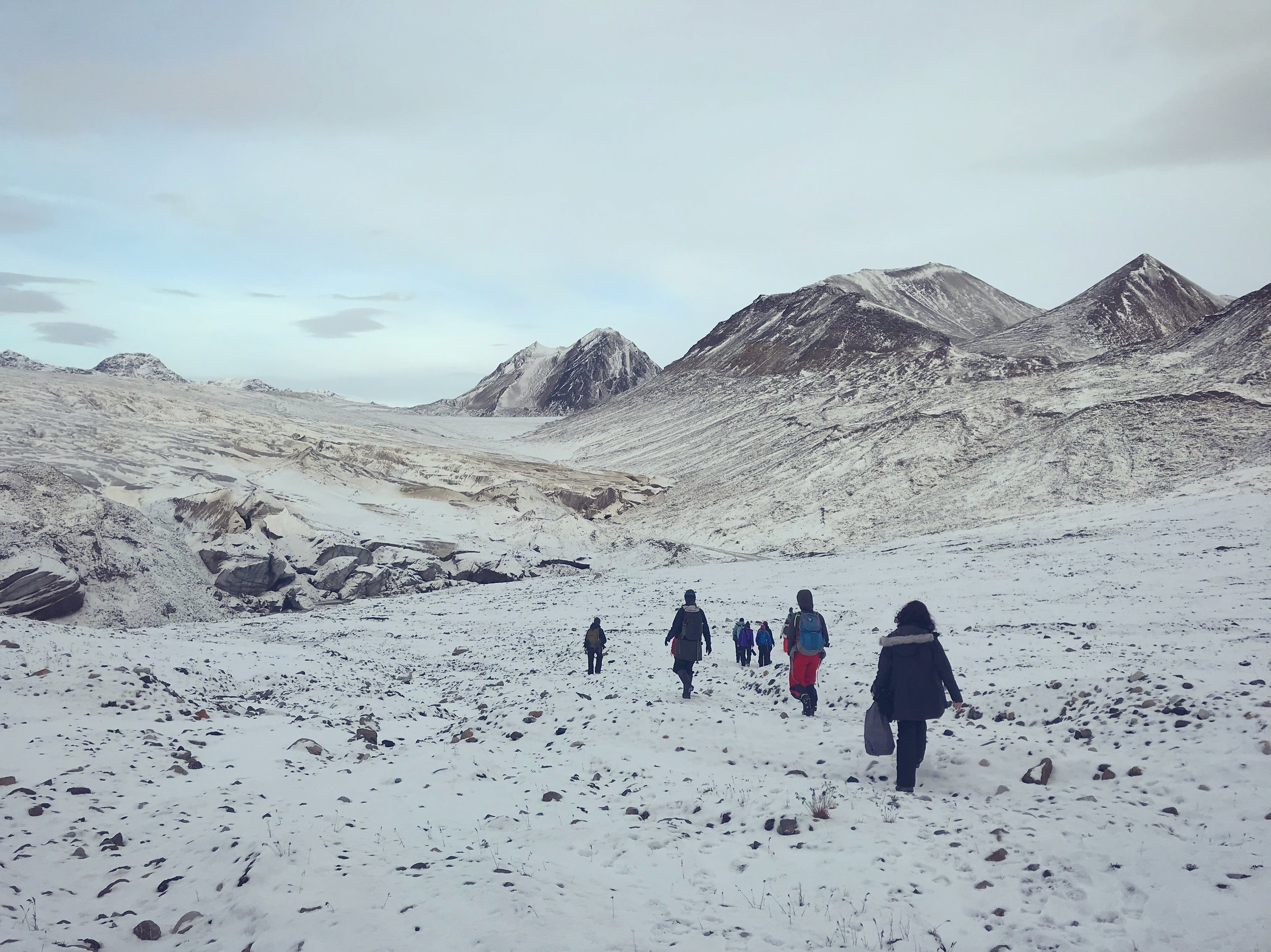 Hiking towards the glacier Esmarkbreen (on the left) at Ymerbukta.