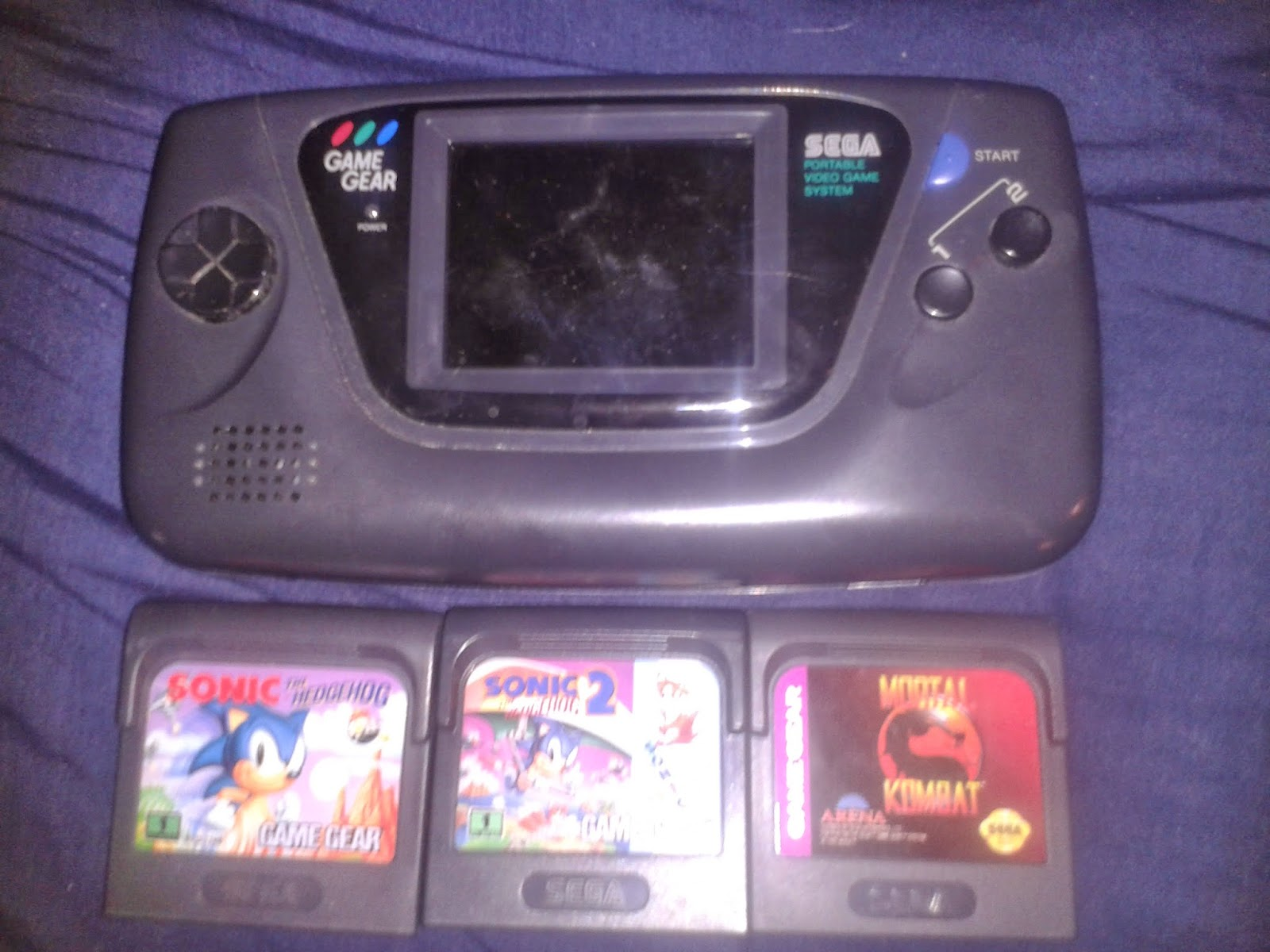 My actual Game Gear and the three games that survived years of family yard sales.