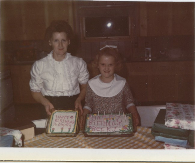 Circa 1970, My Mom and sister Becky celebrate their birthdays together with two cakes.  Photo from the Newvine Personal Collection