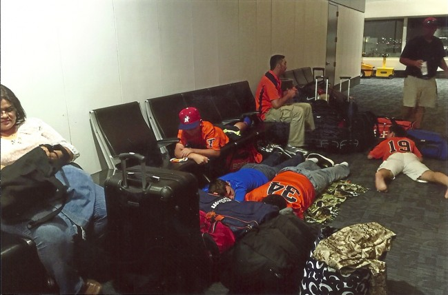 Jet Lagged and Road Weary, the Titans wait in an airport for the next leg of their journey.  Photo by Titans Elite