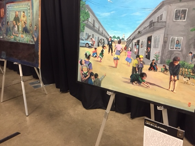 Paintings by Hmong artists depicting life in California. Photo by Steve Newvine