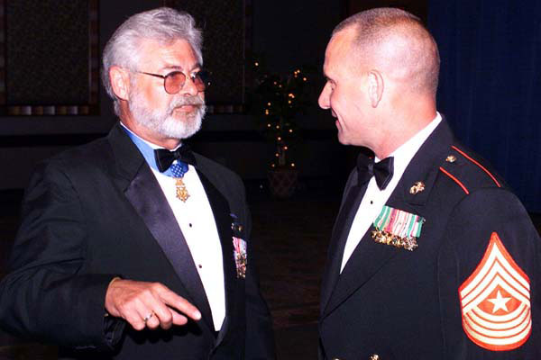 Jon Cavaiani (left) at a ceremonial function.  Photo from Military.com)