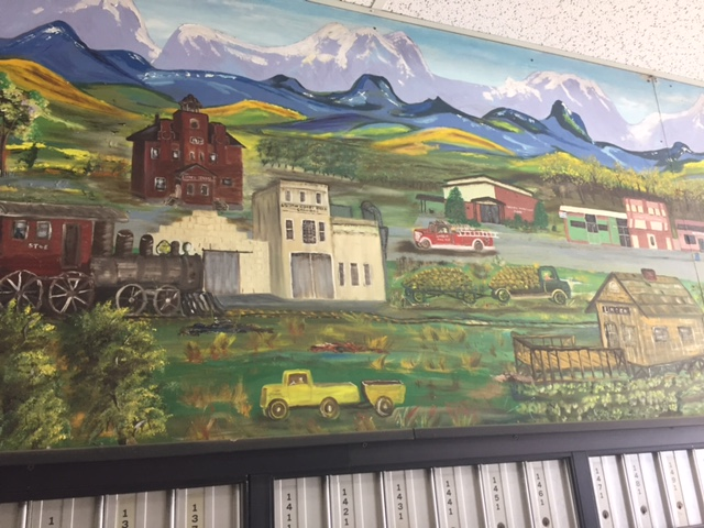 A mural covers the upper interior walls of the mailbox section of the Linden Post Office. Photo by Steve Newvine