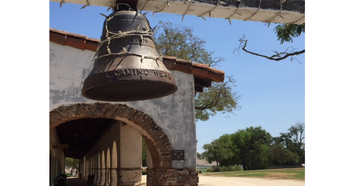The bell in front of San Juan Bautista along Camino Real, translated as Royal Highway. Photo by Steve Newvine