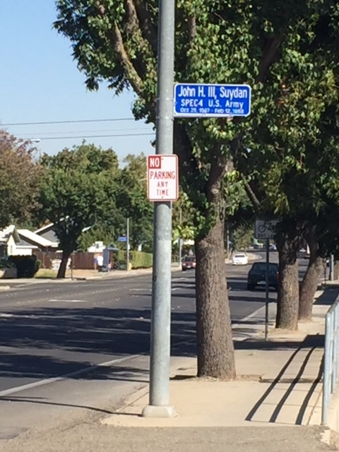These white on blue signs are on utility poles up and down M Street. Each one recognizes the service of a soldier from the City of Merced. Photo: Steve Newvine