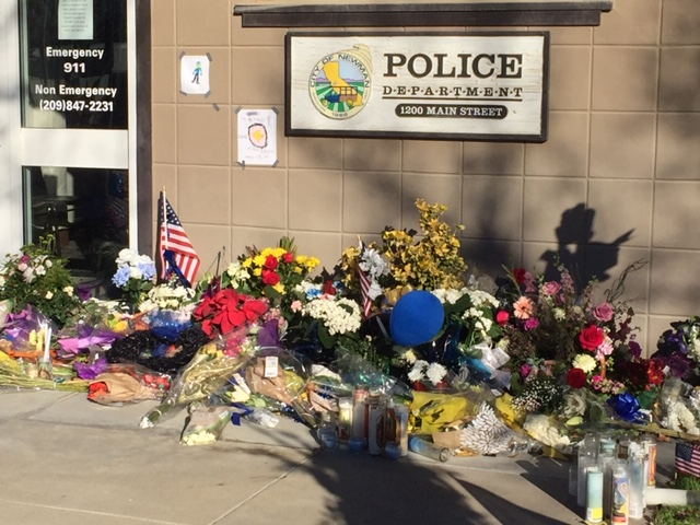 Flowers from all over California have been sent to the Newman Police Department. All the arrangements are on display in front of the Department headquarters on Main Street. Photo- Steve Newvine
