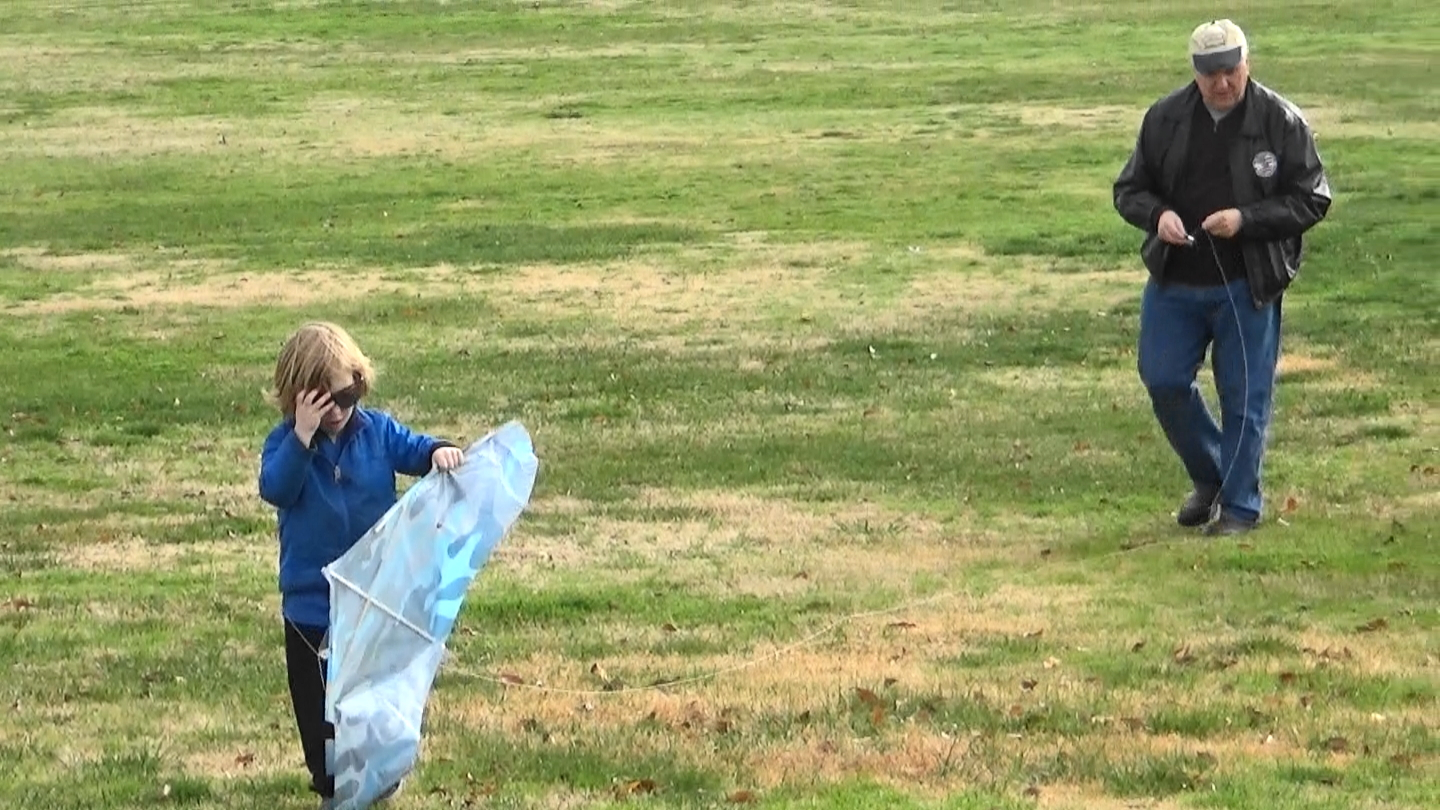 My grandson and me, moments before our kite went in the air. Photo: Steve Newvine