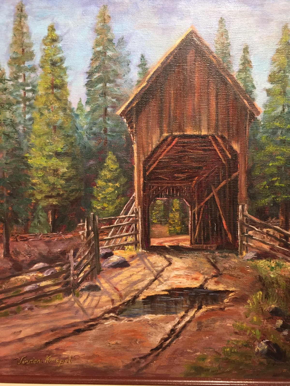 This covered bridge painting that is part of the Originals of Yosemite exhibition is from Vivian Knepel. She was well-known for paintings of a variety of scenes from Yosemite.