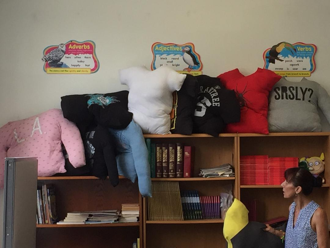 One of the first projects students in the Summer Enrichment and Reading Program embarked upon was stuffing t-shirts for use as pillows during rest breaks. Photo: Steve Newvine