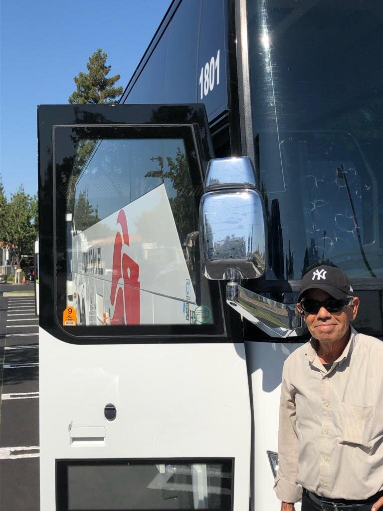 Driver Juan stands in front of his bus. Juan drives for a company based in Los Angeles and he's been to Yosemite dozens of times. Photo- Steve Newvine