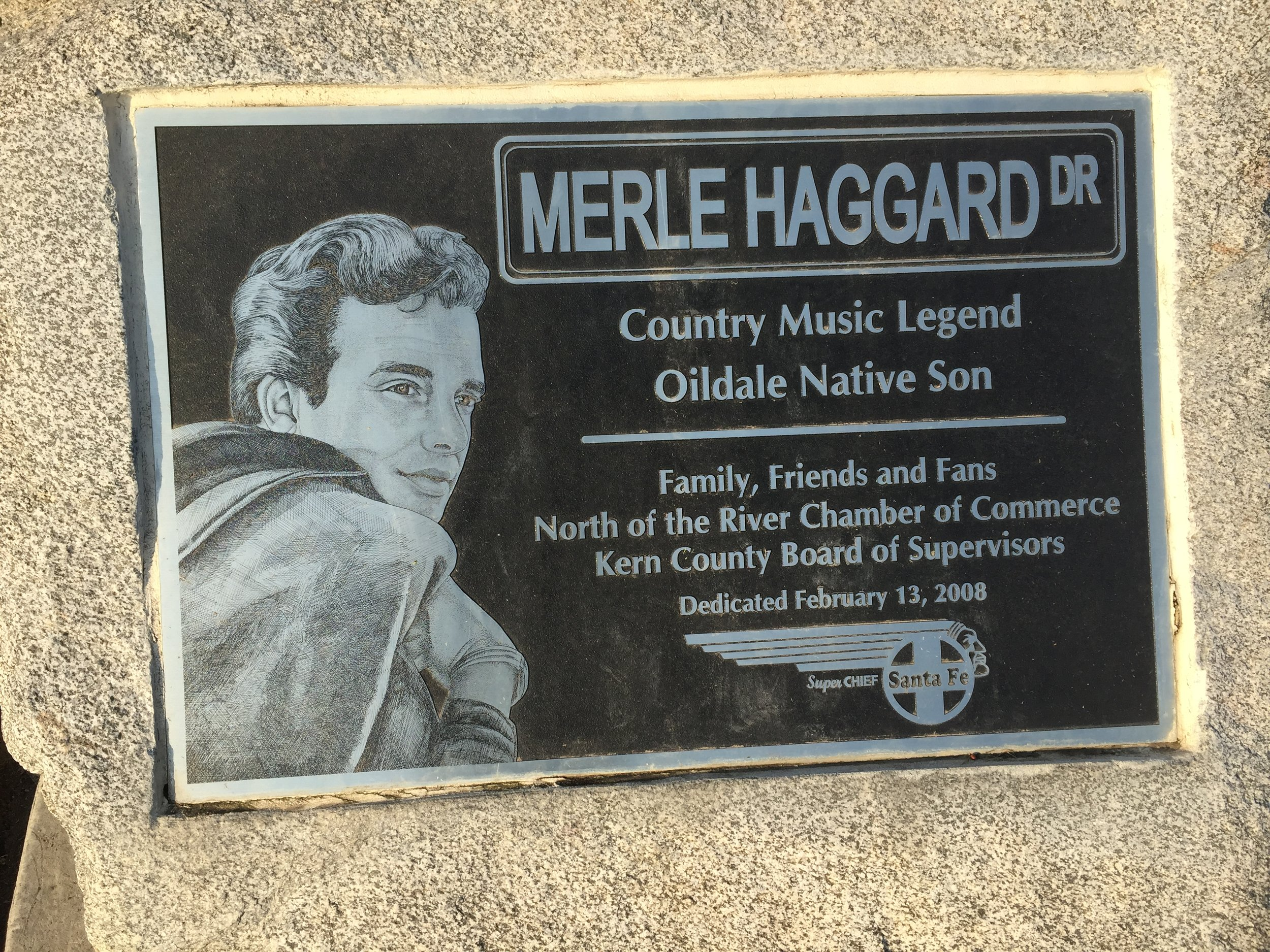 A plaque honoring Merle Haggard sets in front of a Harley Davidson dealership north of the City of Bakersfield. Photo: Steve Newvine
