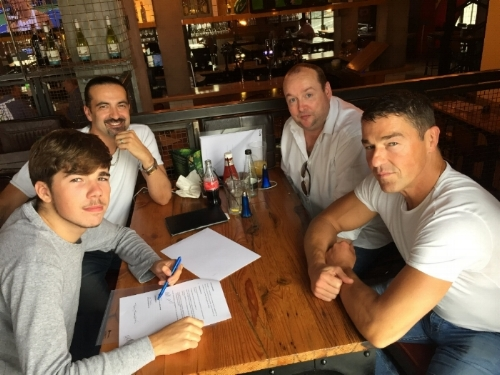 El'tee (bottom left)signs his exclusive management deal with Avenoir's Martin West and Andy Devaney (top left and right), whilst dad, Tony Thompson (bottom right) looks on proudly.