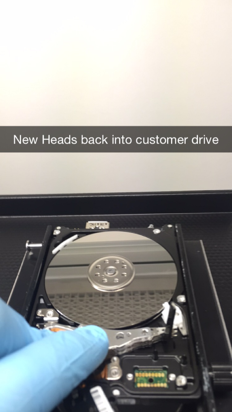 Here I am fitting the new fresh heads that will replace the faulty ones and allow us to recover the customer drive.