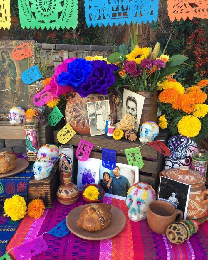 I love how Mexican bean pots, dishes, and   molinillos   (wooden whisks) are part of this altar's   ofrendas   (offerings). Photo courtesy of Casa Artelexia.