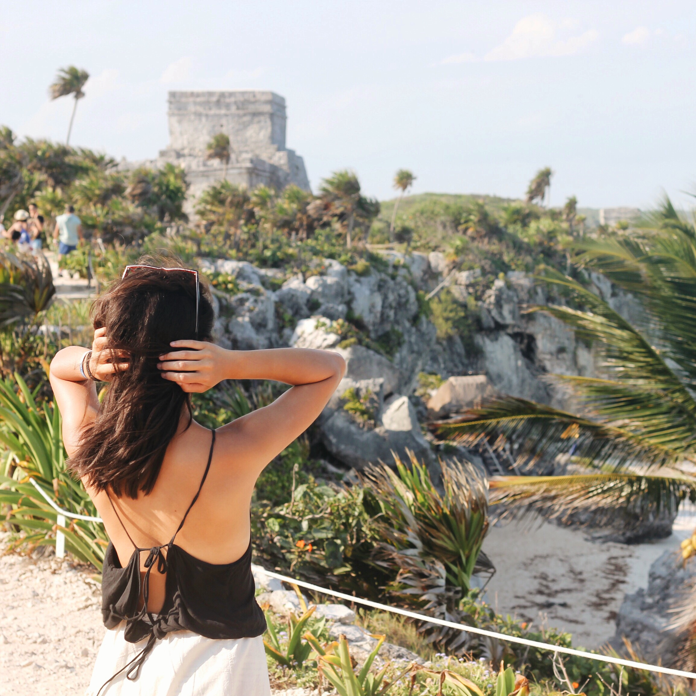 Natalie gazes at the Tulum ruins.