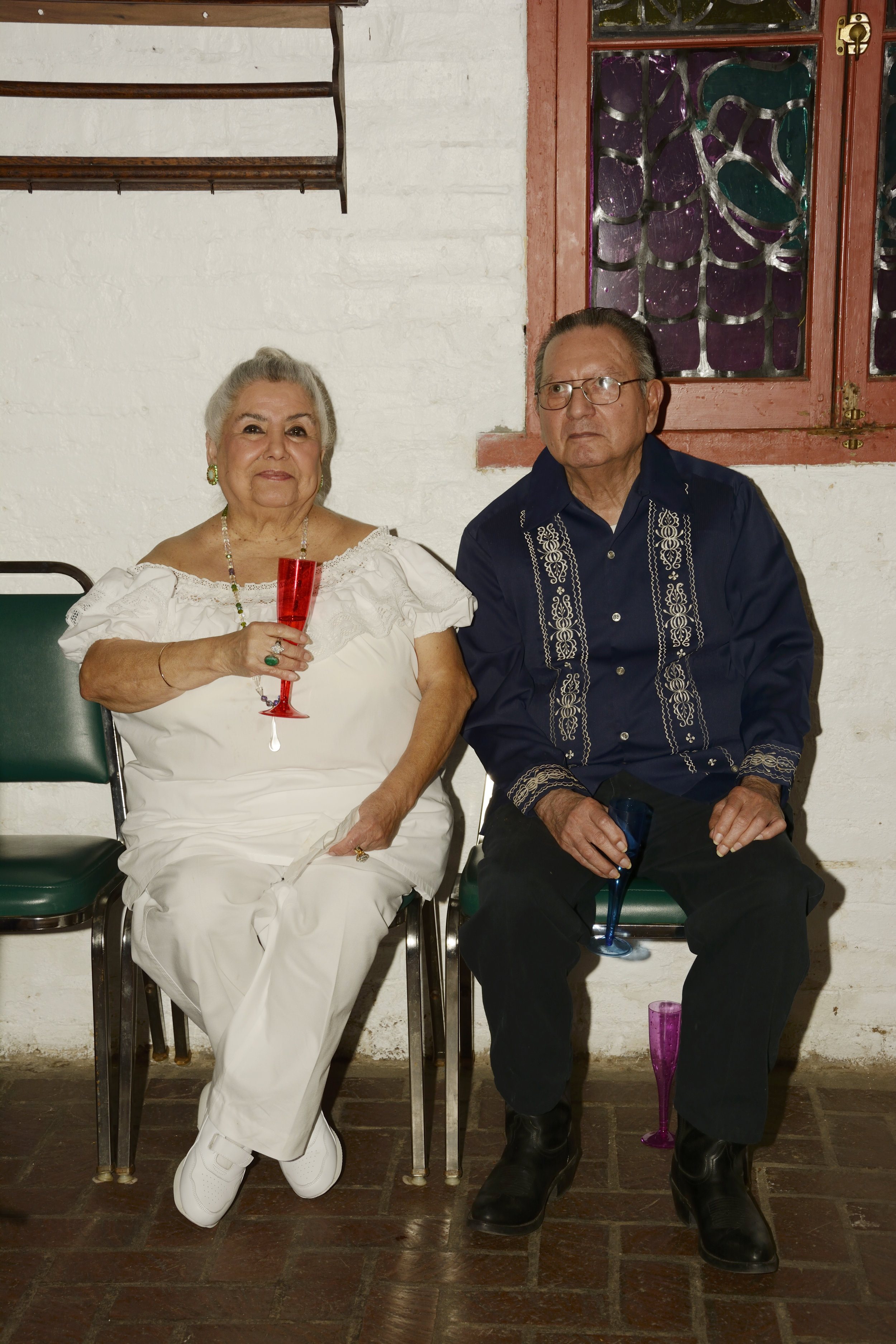 Angelique's grandparents Beatrice (l) and Guadalupe (r) celebrate at her wedding.  (Photo Courtesy: Angelique Sloan)