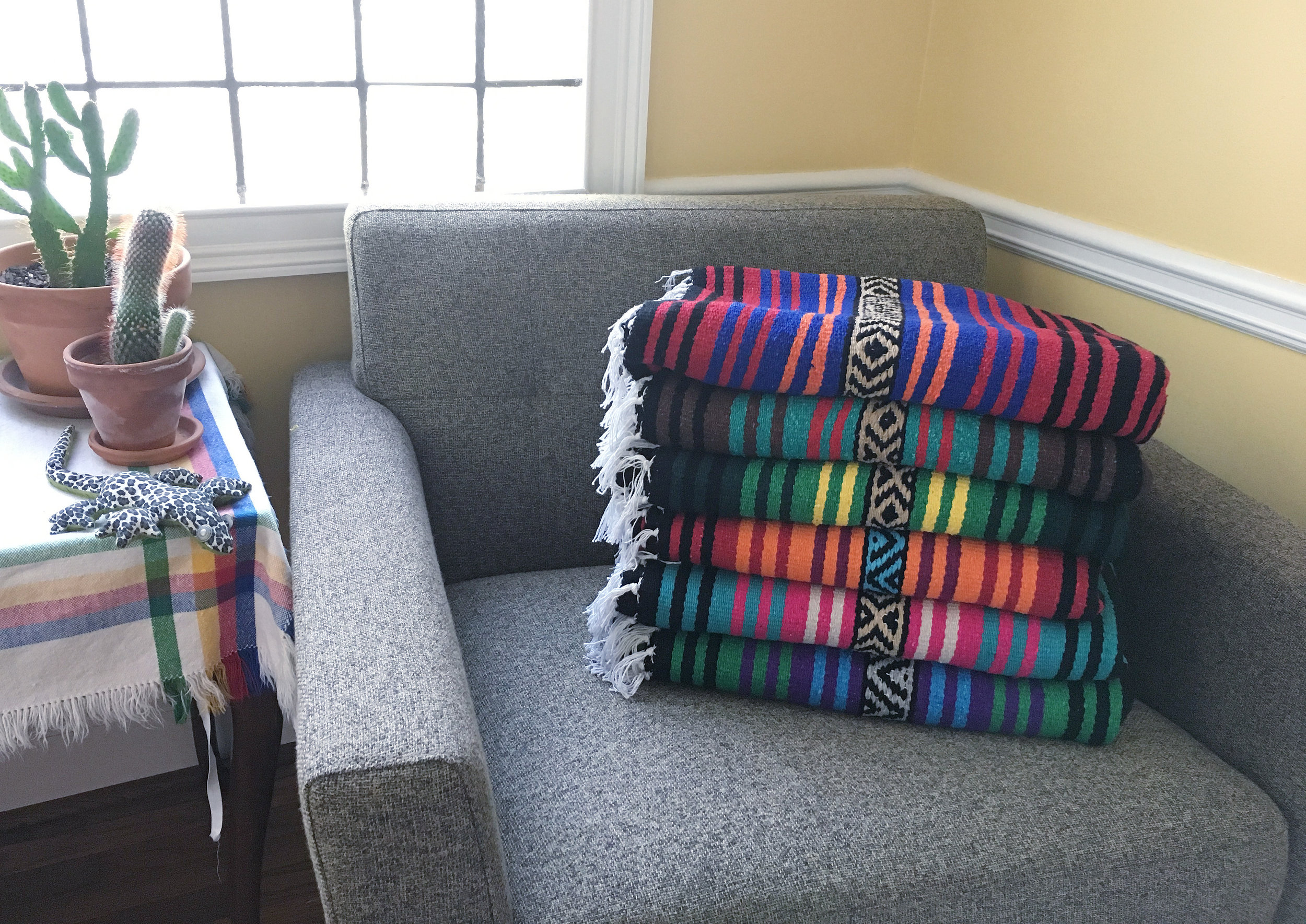 Niño de la Flor throw blankets from ShopMucho.   (Photo Courtesy: Angelique Sloan)