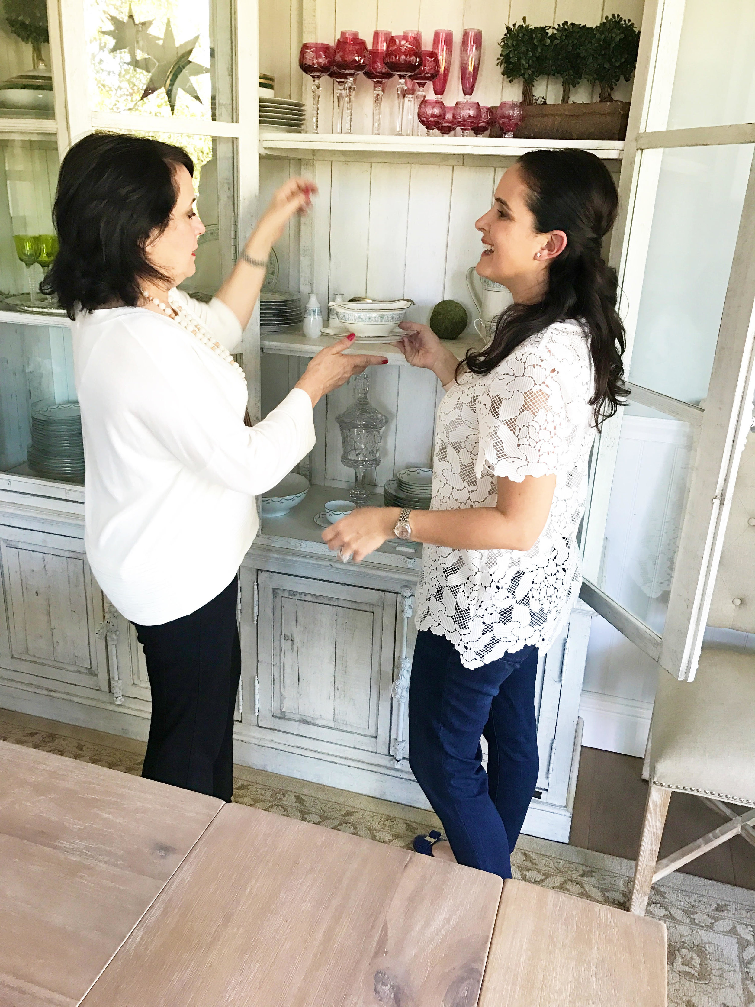 Luz Elena (l) and her daughter Luisa (r) discussing tableware at home.    (Photo Courtesy:   mesachicparties.com  )
