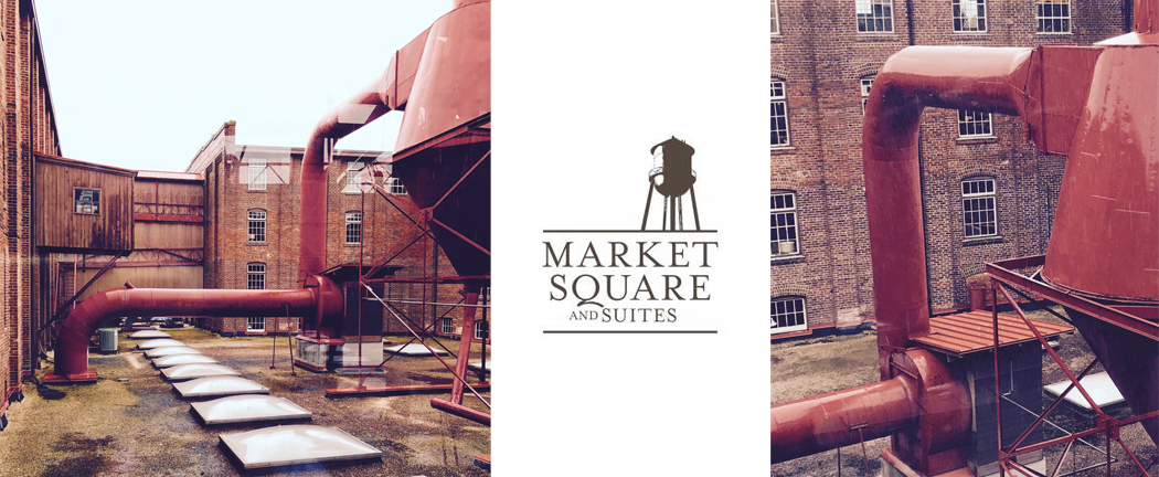 The historic Market Square building is an old furniture factory compound. A five-story brick beauty complete with water towers, covered walk bridges between buildings and gorgeous original hardwood floors through most of the building.