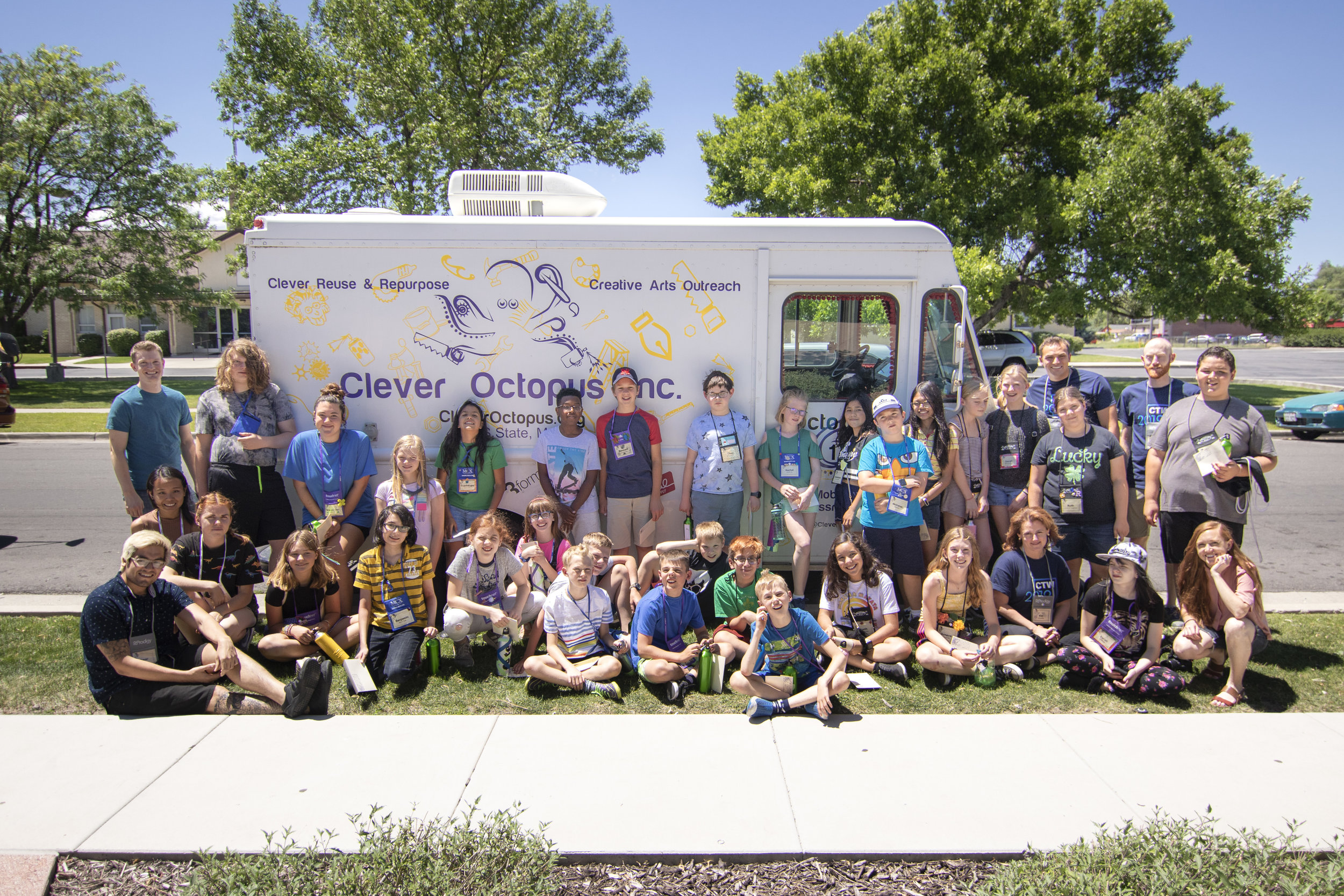 The student-artists + staff in the front of the Octopod, Clever Octopus' outreach mobile vehicle.