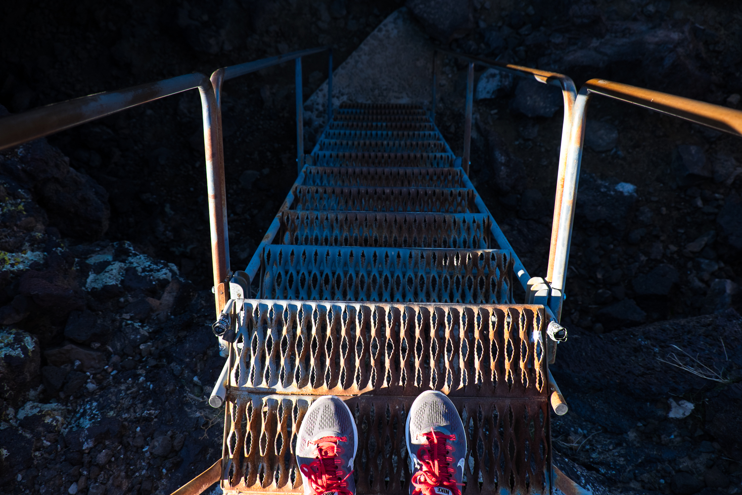 Toes waiting to go down into a lava tube!