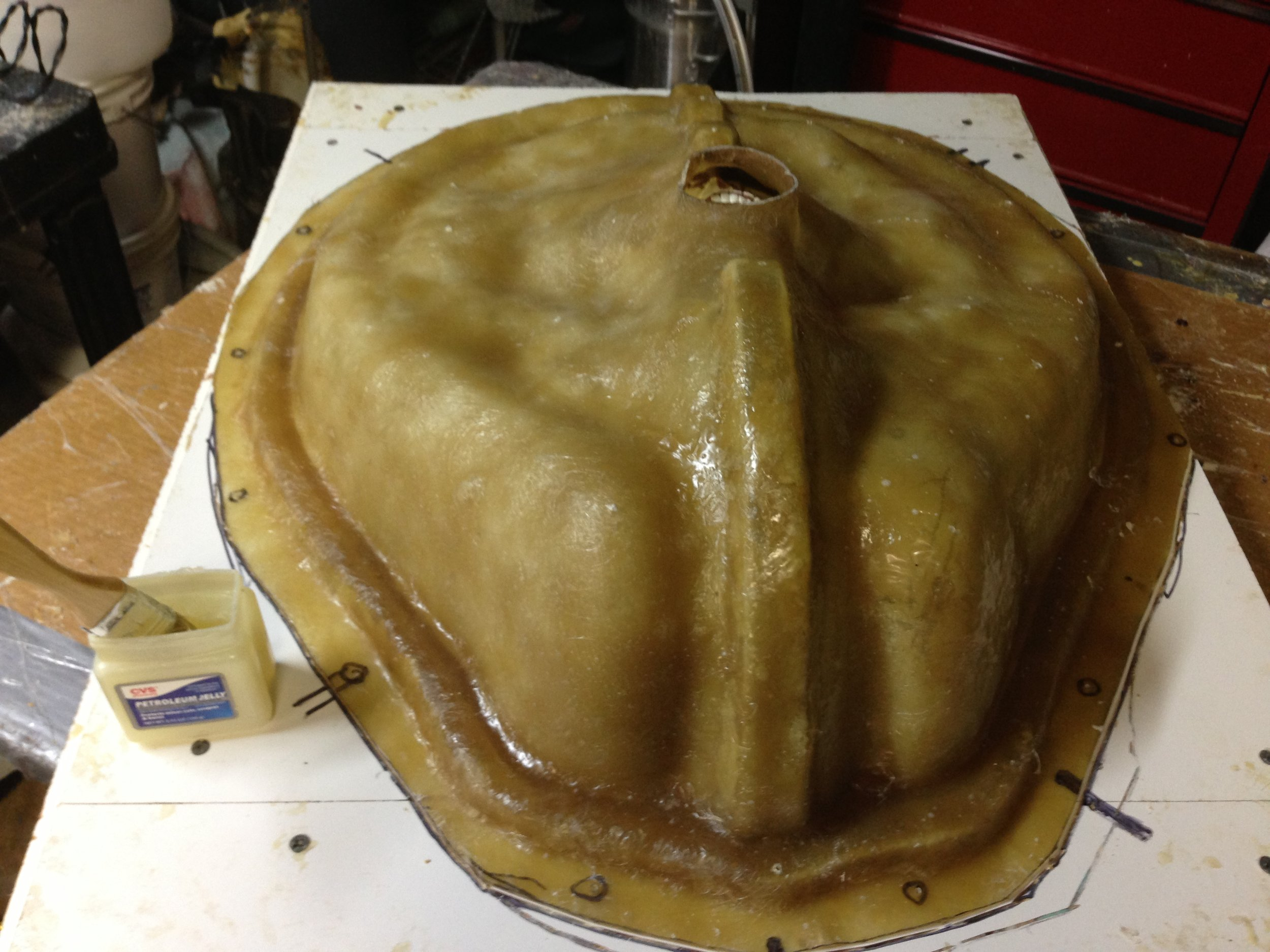 Fiberglass jacket over clay lay-up