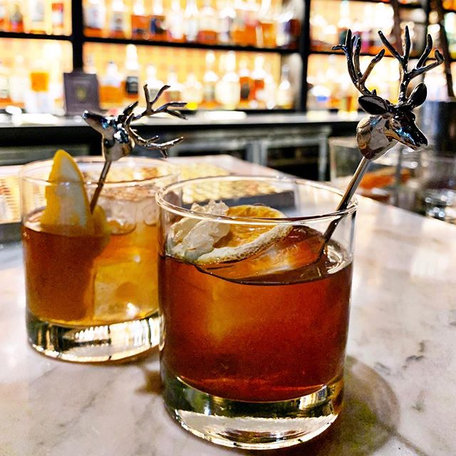 Colorado ( @woodycreekdistillers rye) and House Blend ( @fourrosesbourbon & Old Crow) Old Fashioneds at @sevengranddenver courtesy of @jdmcdouglas plus the obligatory Stag garnish.  #originalhipstirrer #playwithyourcocktail #stag #deer #buck #oldfashioned #whiskey #bourbon #rye #denver #whiskeybar #dairyblock  @dairyblock @jimbeamofficial @suntorywhisky