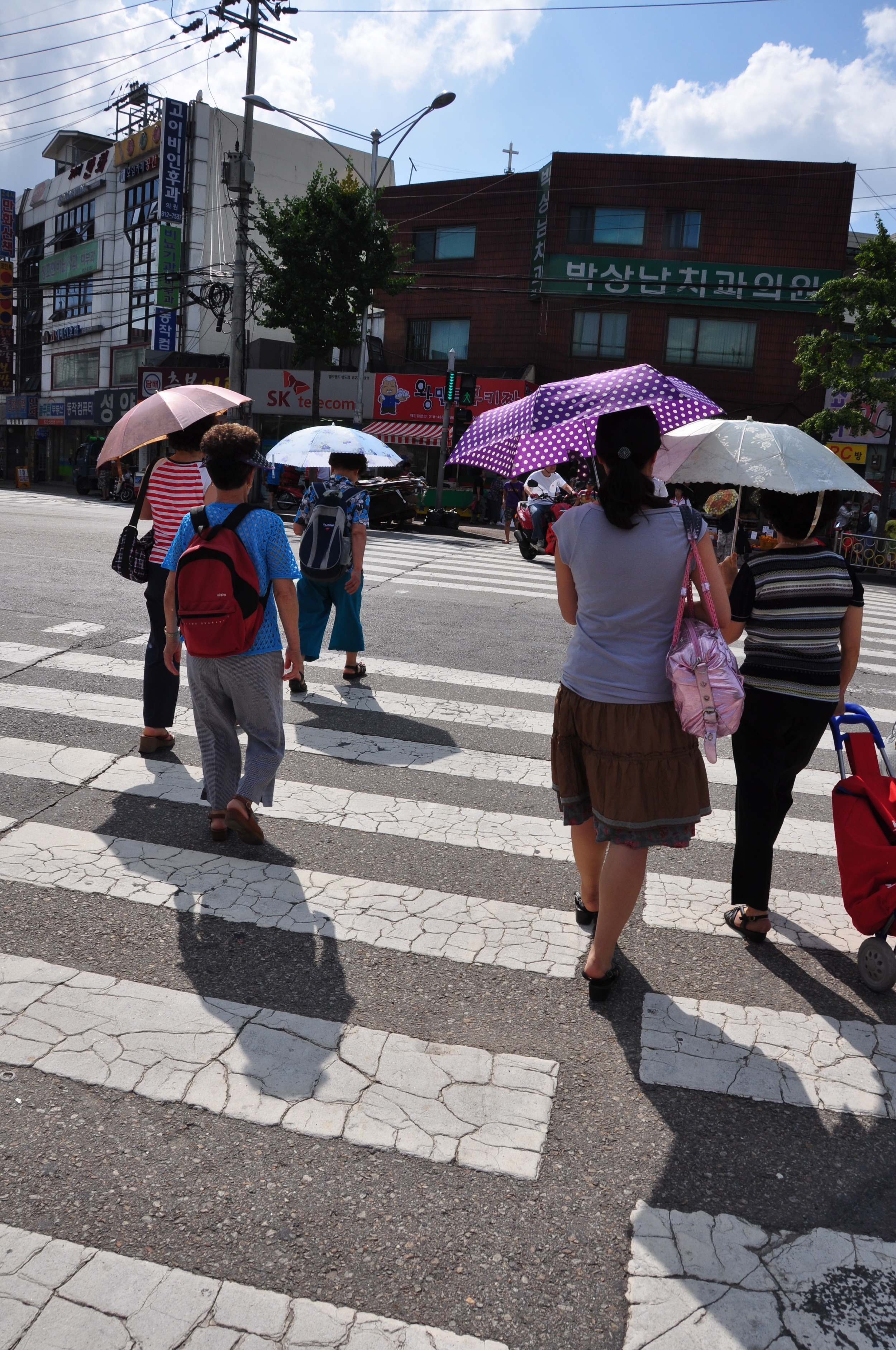 Unlike westerners, who generally enjoy suntanning, Koreans prefer to protect their skin from the sun.