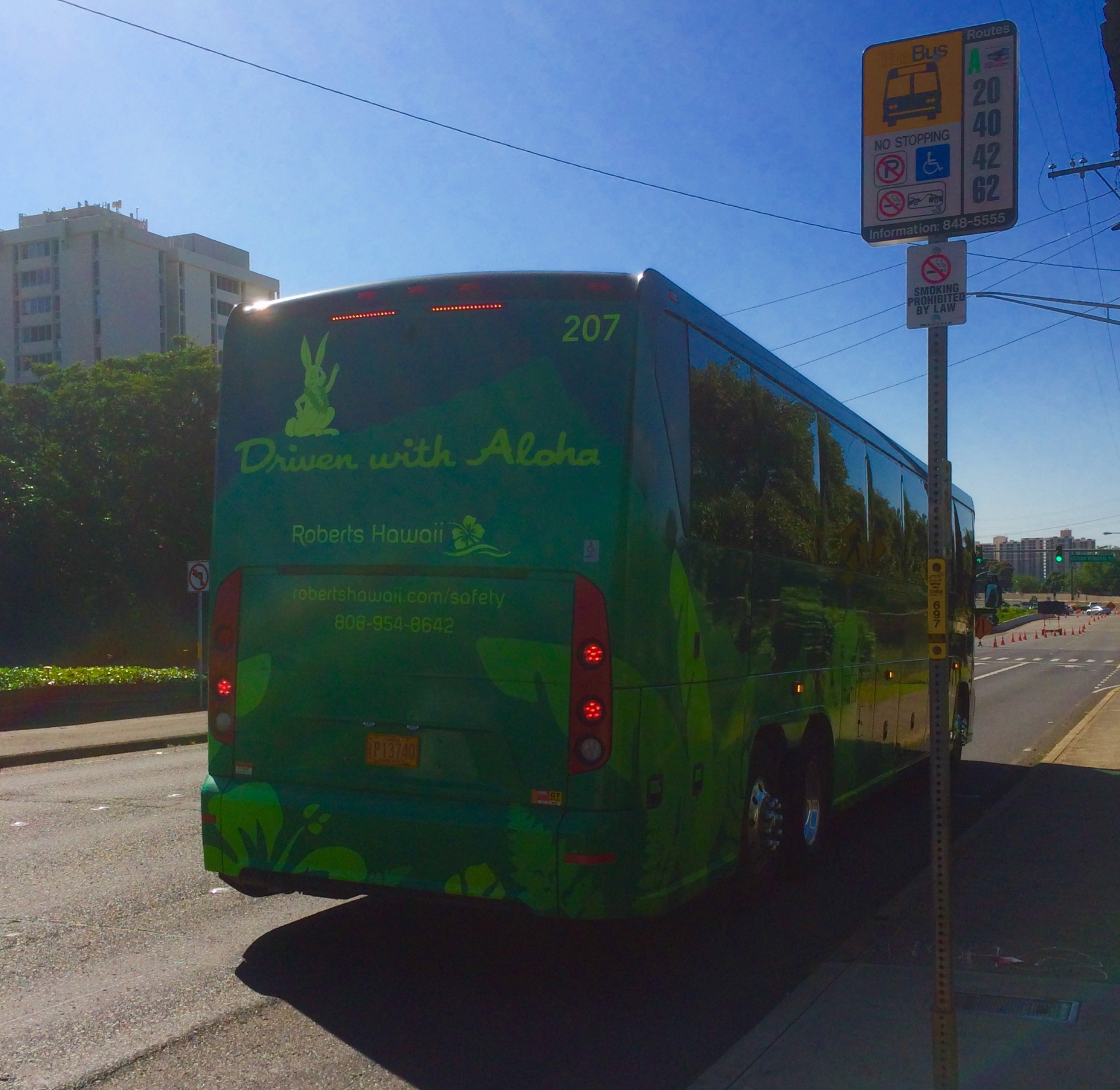"a tour bus says it's ""Driven with Aloha"""