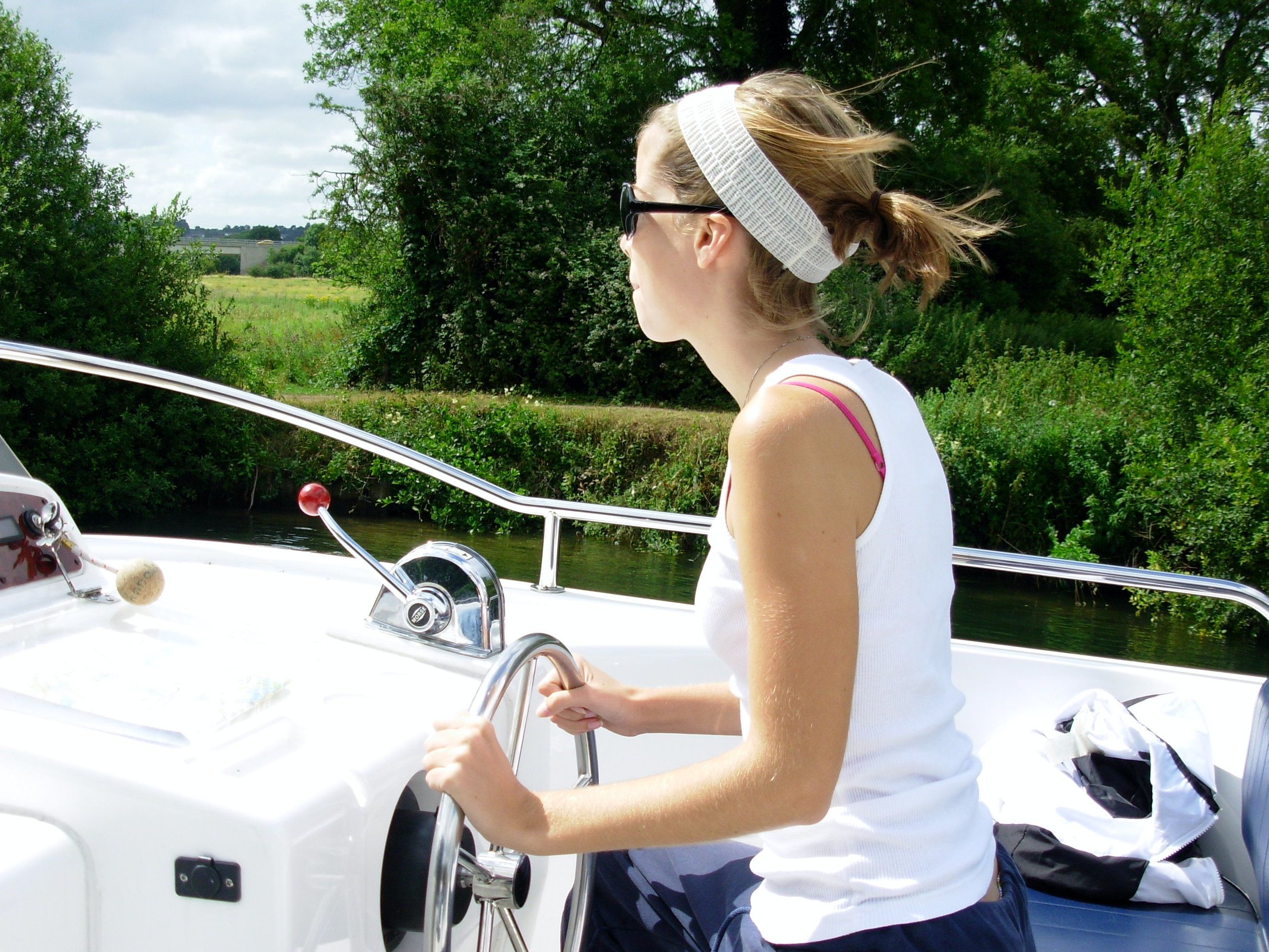 "My family rented a boat and sailed down the Thames for a week. (Check out my concentration as I take a turn behind the wheel.) If almost capsizing the boat in a lock is ""once-in-a-lifetime"" and unique, we had a very luxurious trip."
