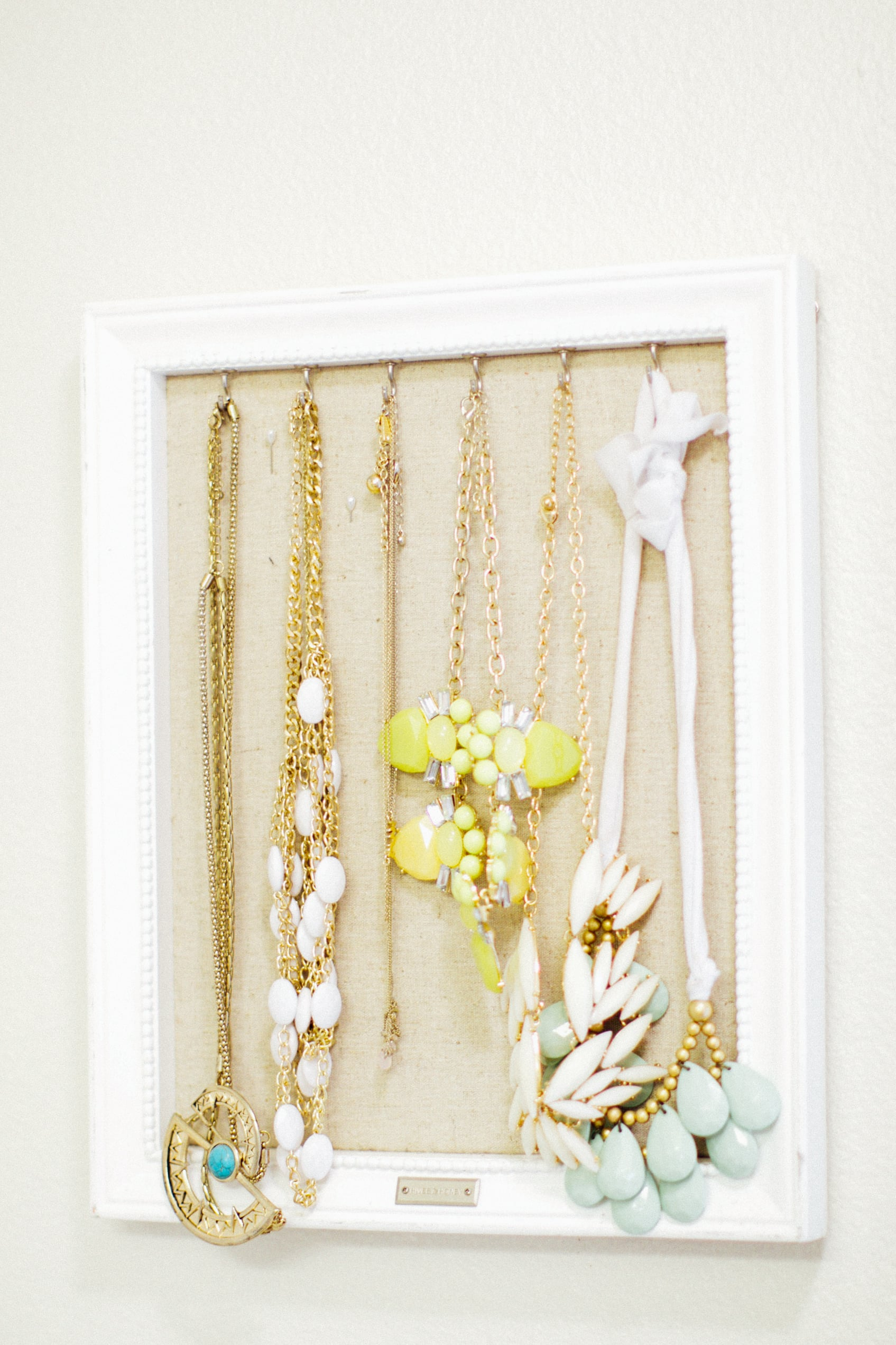 One of my jewelry organizers that hangs on the bathroom wall. I got it at francesca's this past summer! I just adore seeing all my necklaces organized instead of tangled up! These necklaces are from J.Crew and Forever 21 but are older so not listed -- linked some similar below! THe green one on the right is from my friend CArrie Grace's shop! And the white one is from Wal Mart (of all places!) but guess what? wal mart is like the world' best kept secret on stylish costume jewelry. Seriously, $2 earrings. You'll thank me later.
