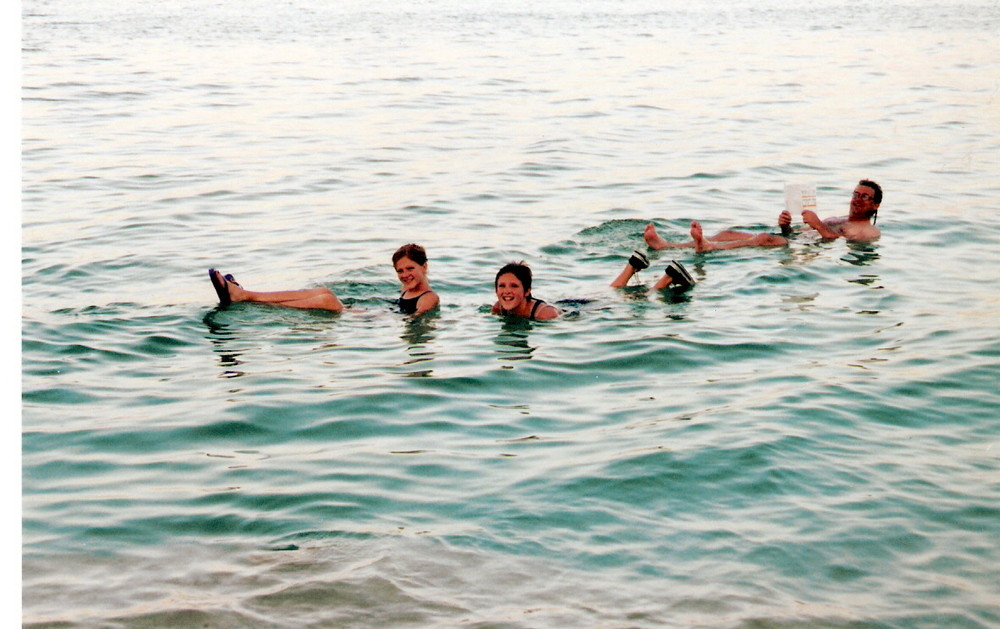Floating in the Dead Sea with Dad and Sis. Israel, 2000.