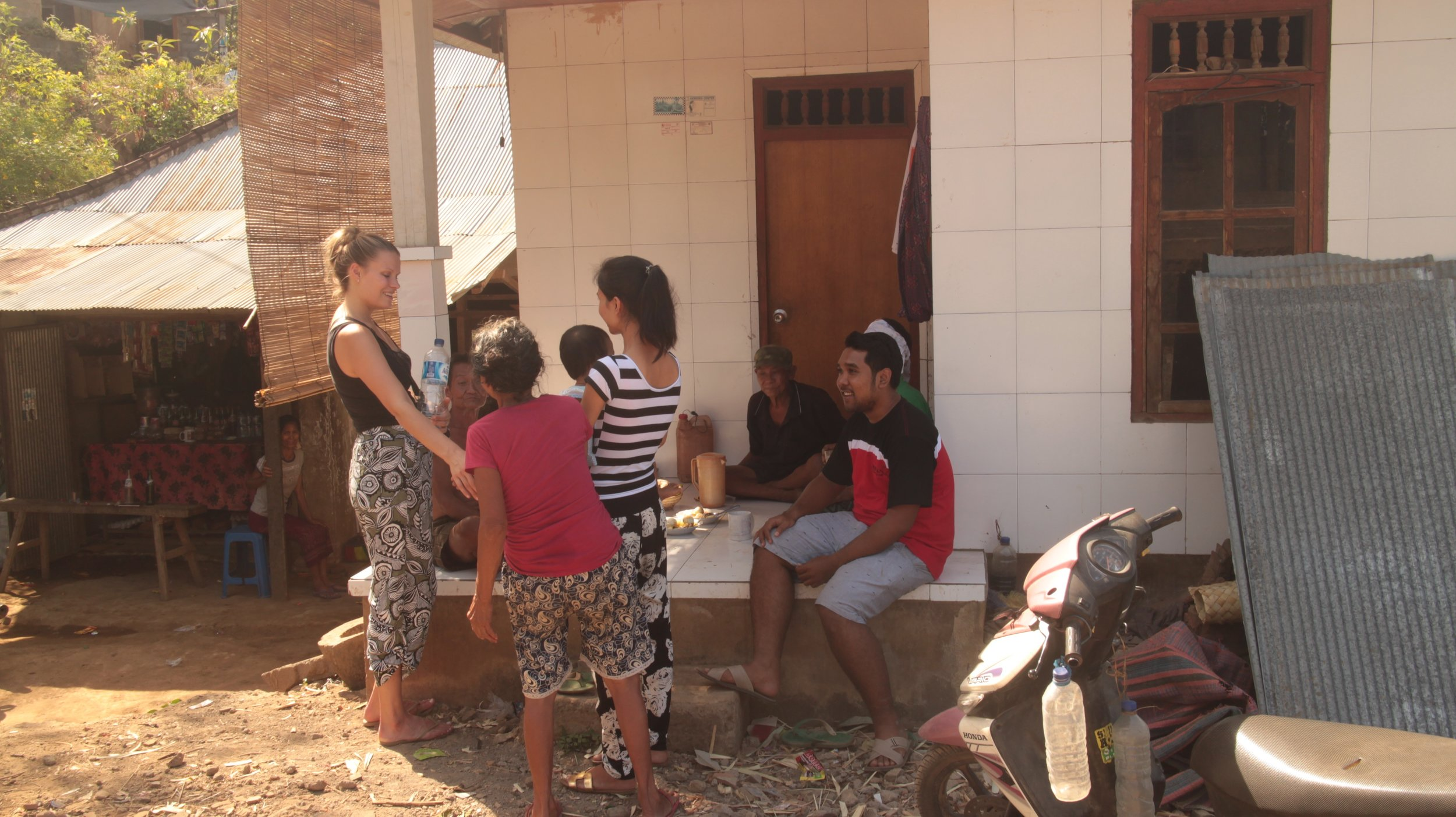 Suri, in the middle and Adi on the right meeting village leaders with Elina from Duara.