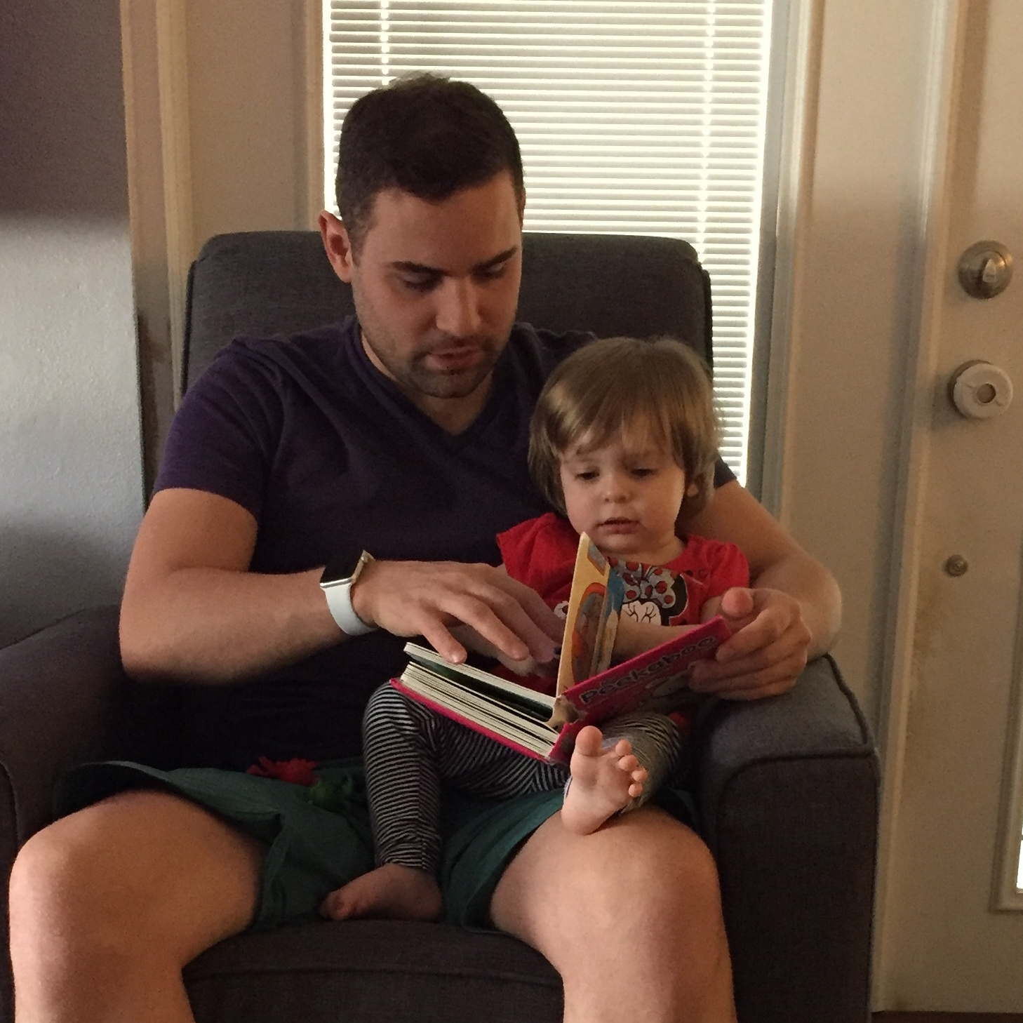 Photo of baby Bella and Uncle Cory reading a book.What books did you love as a child?