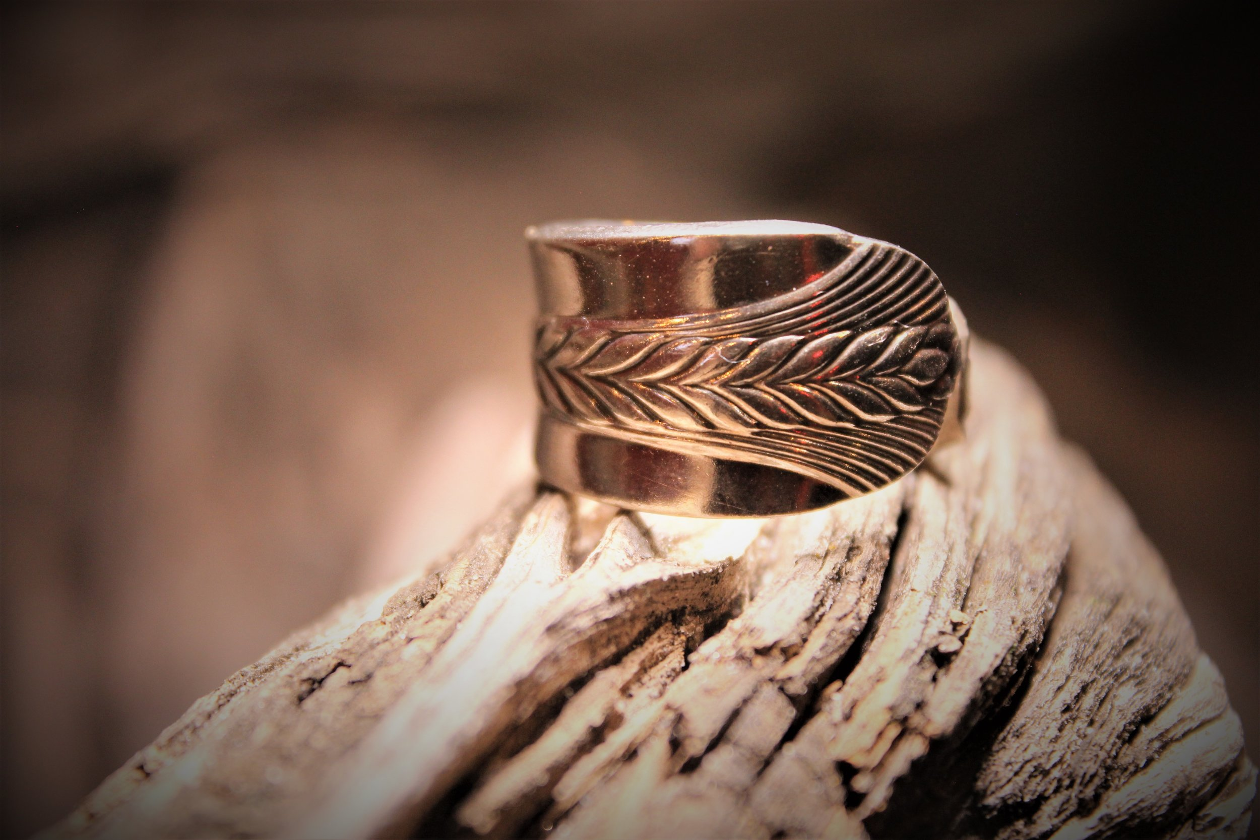 RINGS - Whether you are looking for a simply styled sterling silver plated ringcreated from vintage silverware,or a wedding band stampedwith a loved ones name, we can createa piece that is special and unique.