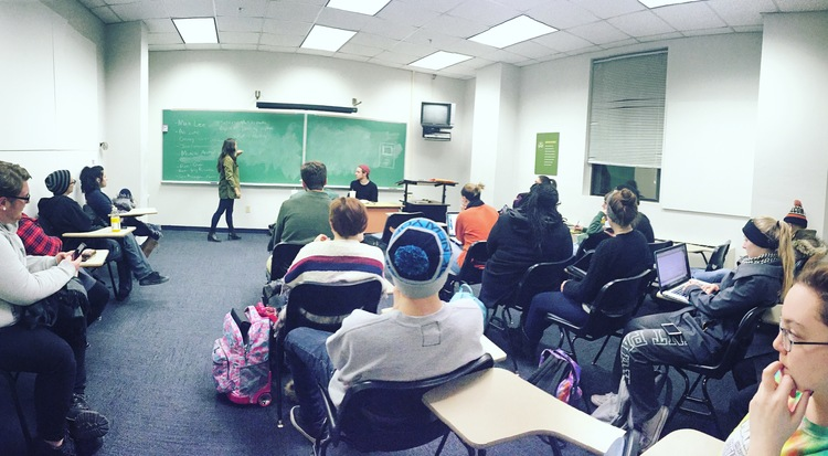Newly elected Senior Photo Editor Hannah Altman leads the group in the first pitch meeting of 2016