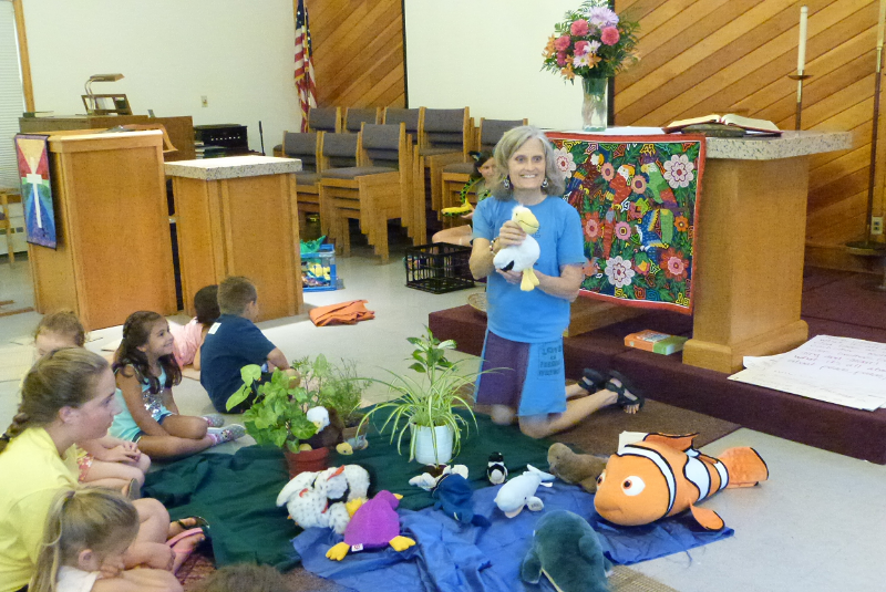 Pastor Lisa of St. Andrew Lutheran Church leads a story hour during our summer KinderCamp