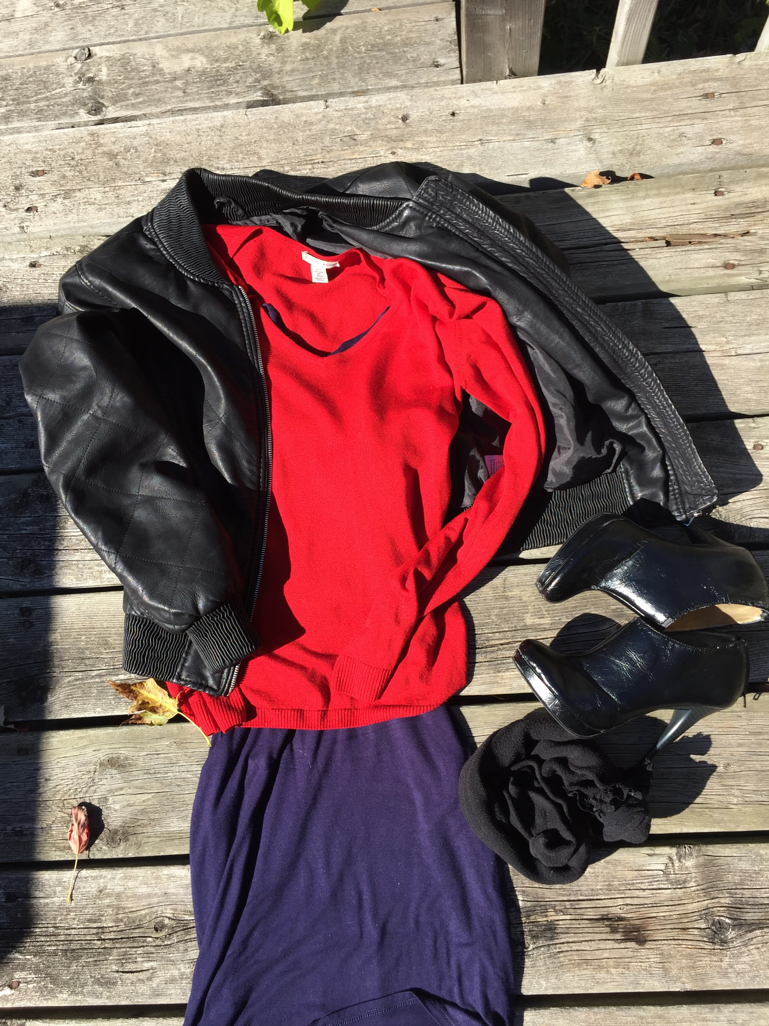 Navy dress, red cashmere sweater and faux leather jacket