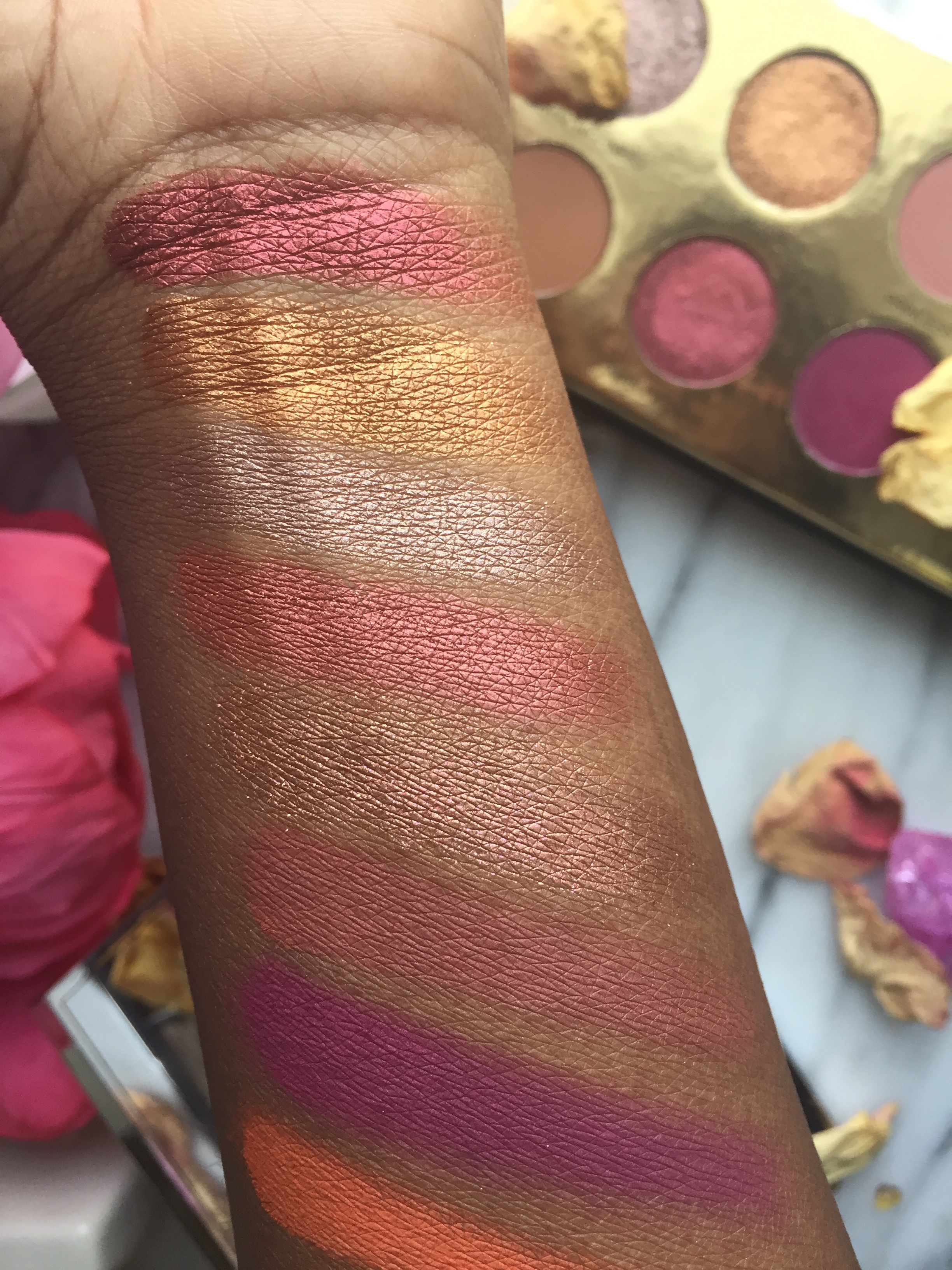 Swatches of Queen of Hearts and Wanted Palette