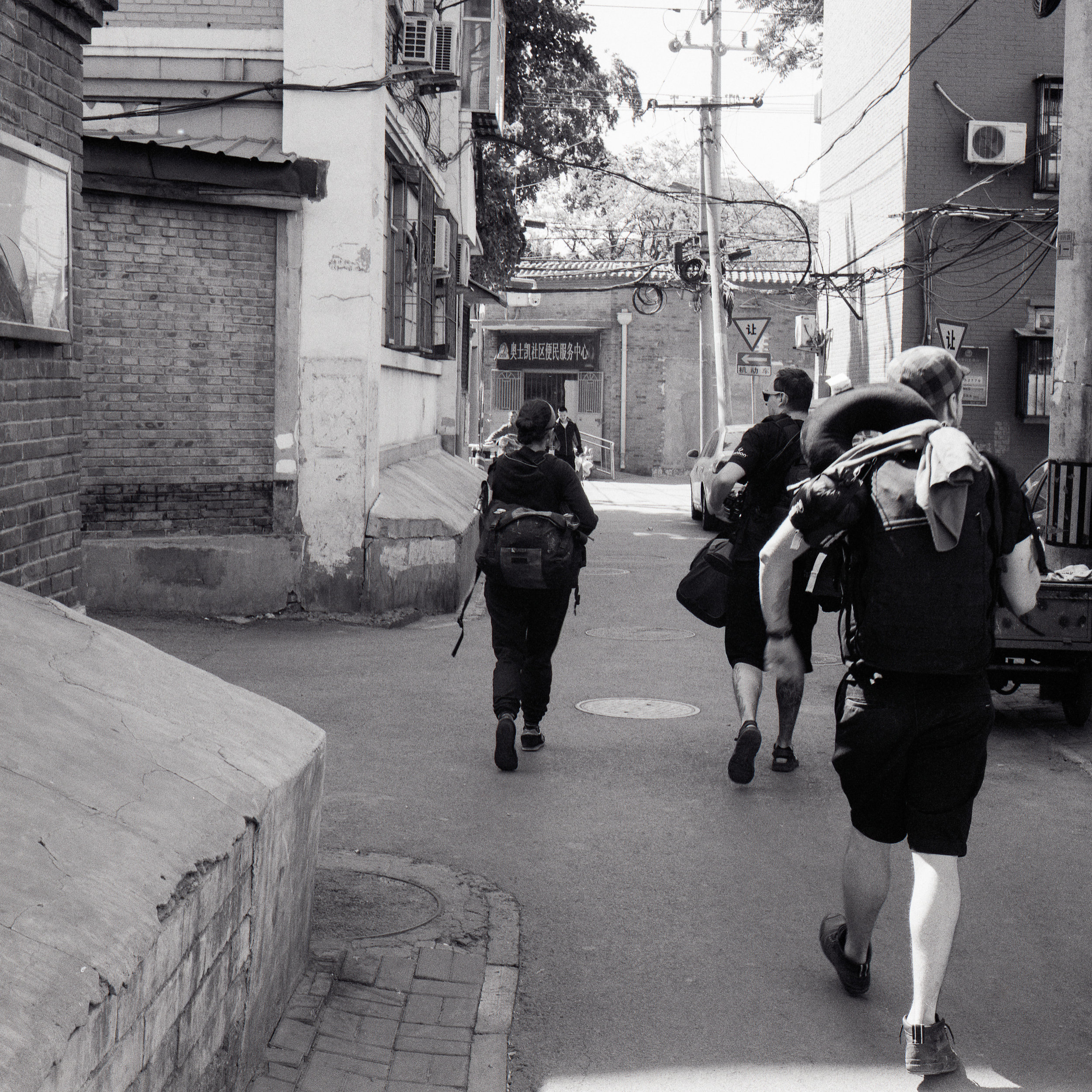 Headed through the back-alley maze to the train station Fuji GF670   Ilford HP5