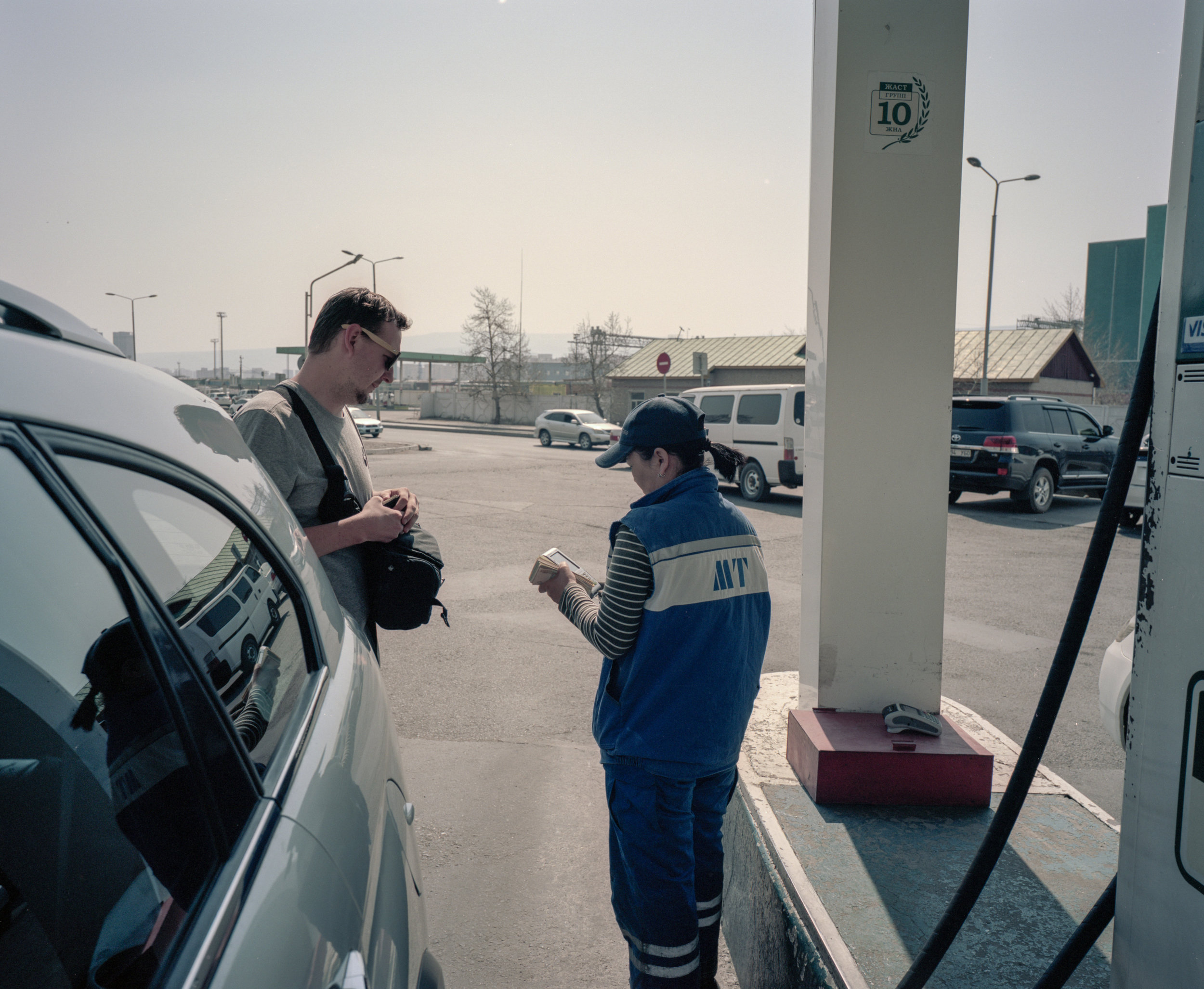 Nate did not understand that the attendant pumps the gas Fuji GF670w | Kodak Portra 400