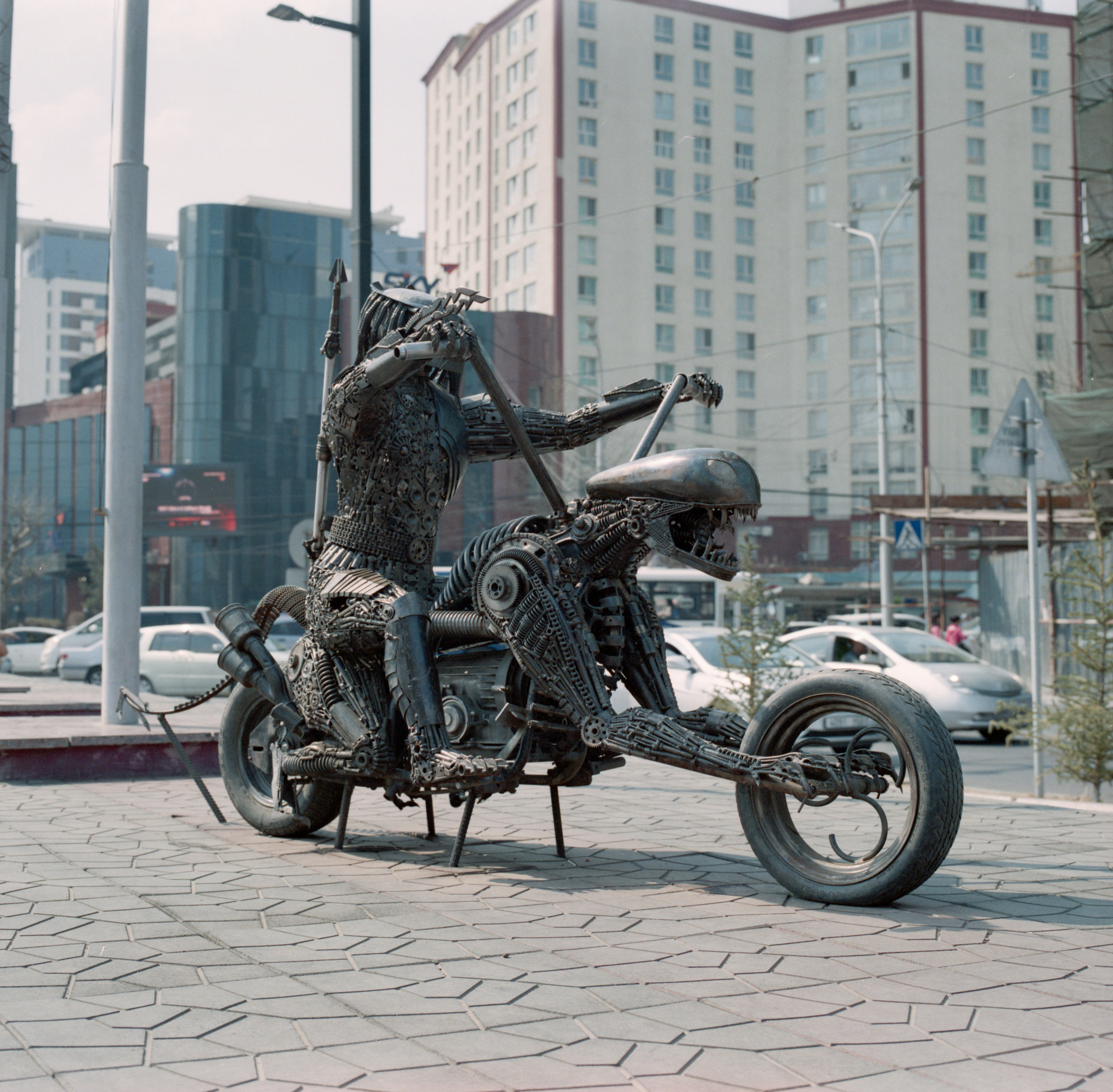 Predator riding Alien, made out of nuts, bolts, and random parts Fuji GF670 | Agfa Vista 400