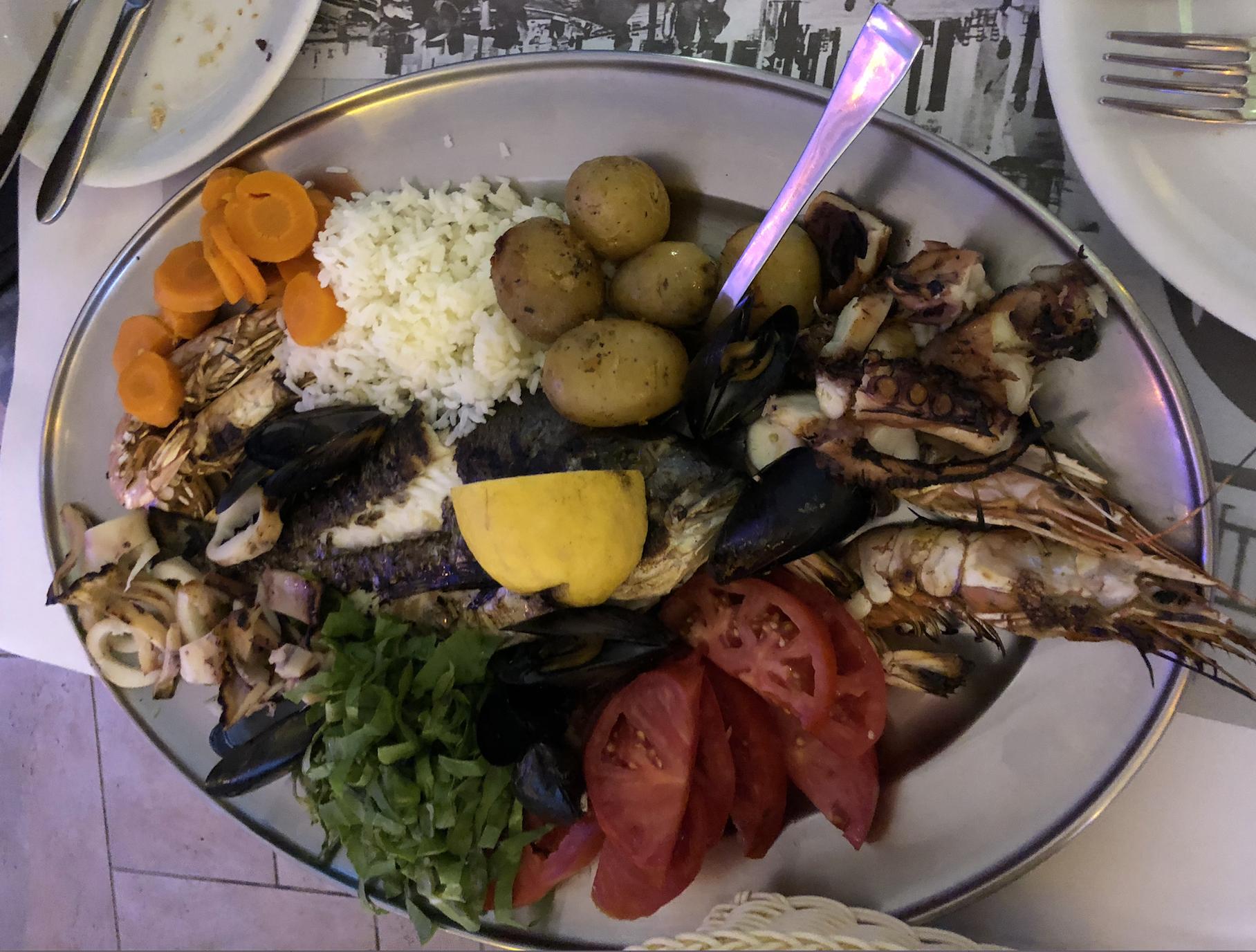 Seafood platter for 2 included sea bream, shrimp, grilled octopus, grilled shrimp.