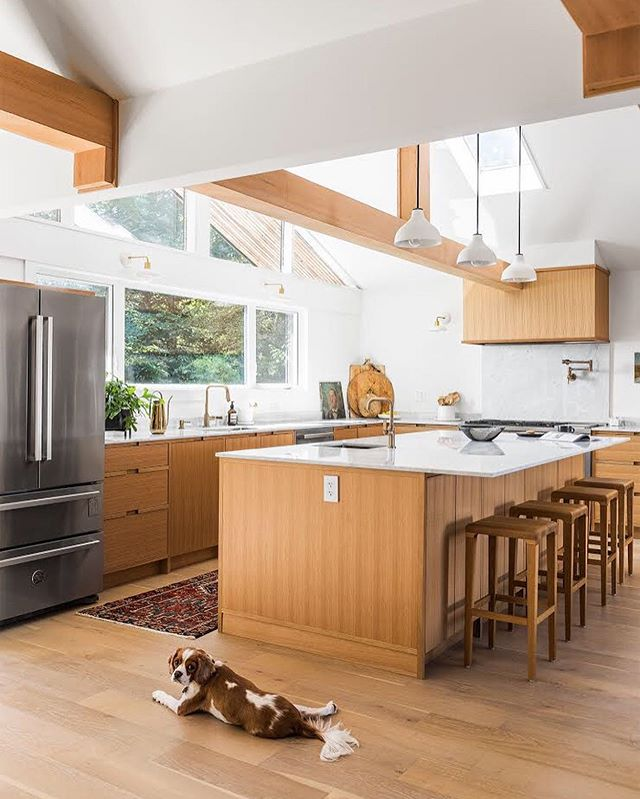 Another view of yesterday's kitchen, featuring Benny. 🐶Swipe for the before photos. The fridge is in the same location and the walls dividing the dining/kitchen/entry were removed. What do you think? Quite the difference! Millwork by Splinters. Photo @jodybeckphotography.  #kitchendesign #yyjdesign #beforeandafter