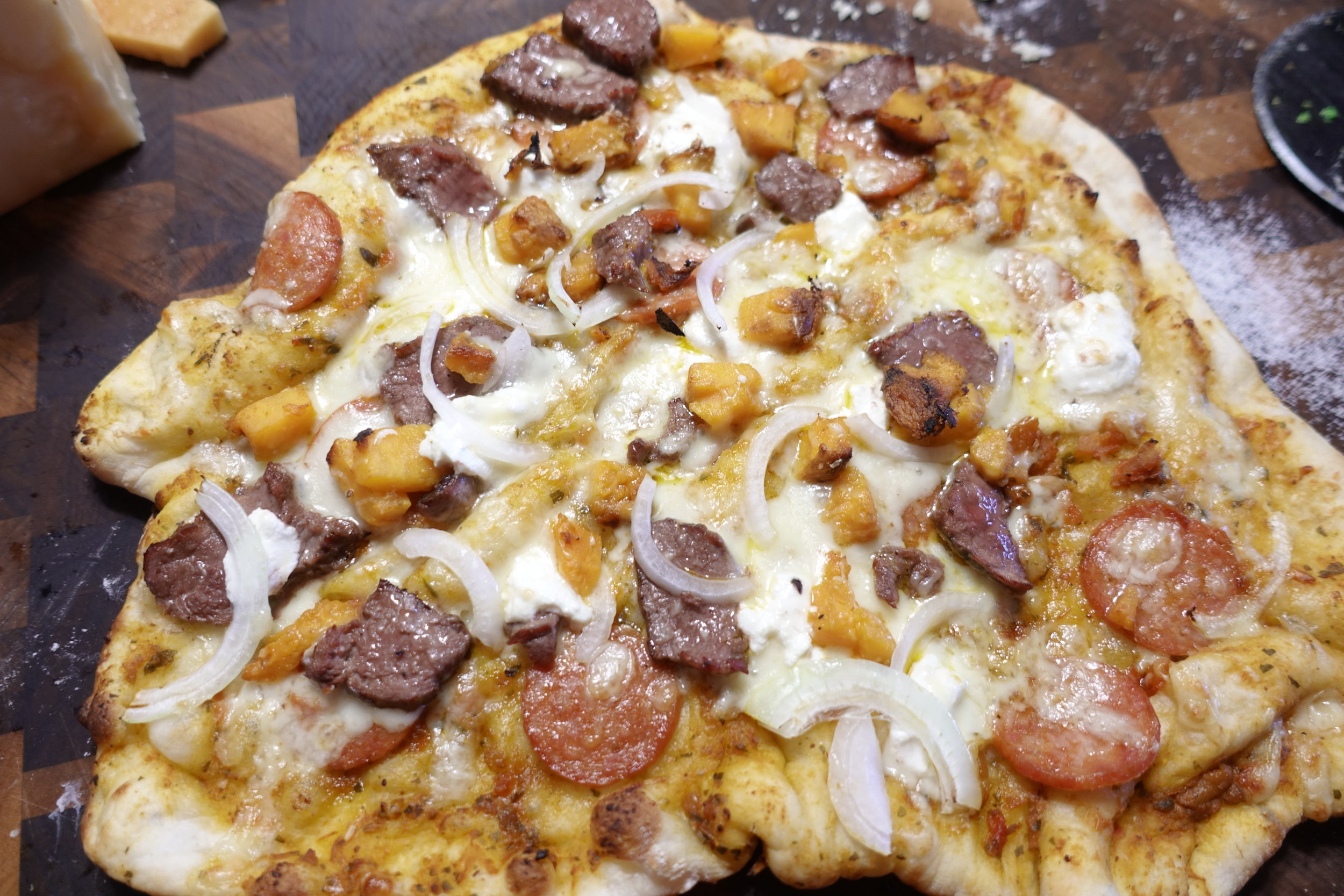 Chorizo, Pepperoni, Sweet Potato, Onion and Cheese Pizza (Goat, Mozzarella and Parmasan)