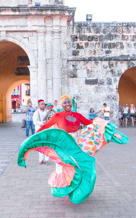 Lady dancing outside the entrance to The Walled City, Cartagena