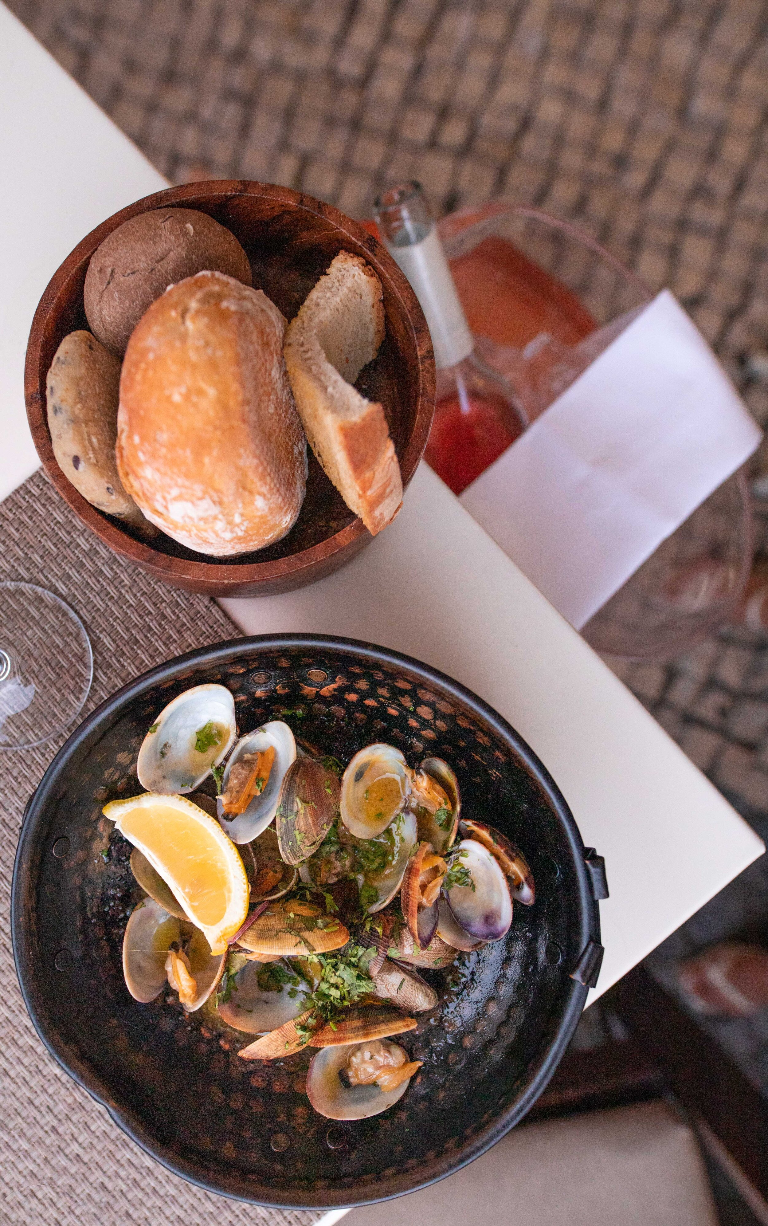 Bulhao Pato Clams cooked in Cataplana  sauteed in olive oil , garlic and coriandar