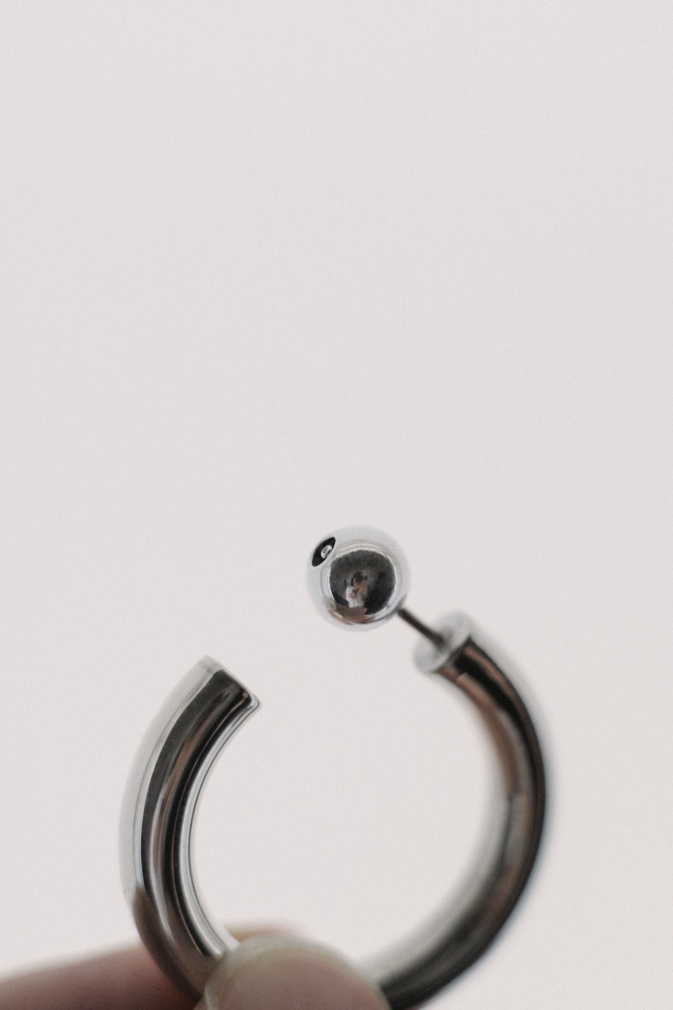 Sophie Buhai Small Everyday Hoops — language of the earring carries through to the push-back closure