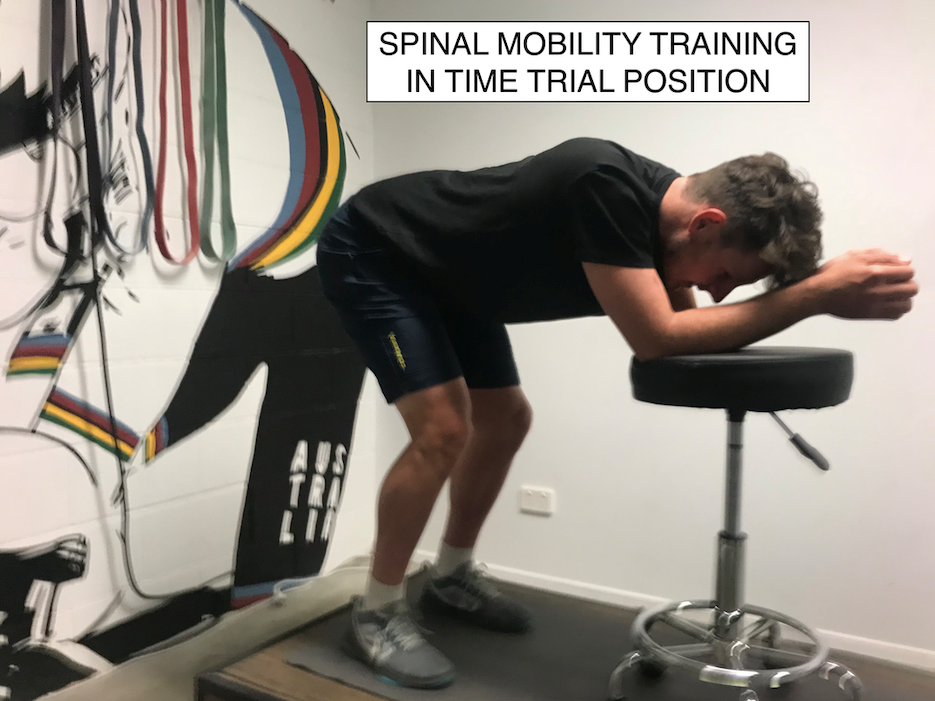 Part 2: - Progress to resting your elbows on a table or chair with your feet slightly apart and knees slightly bent. Now can you straighten your back?Again, identify the muscle group that may be restricting you. Again, this will generally be hamstrings, calves, glutes, back and shoulders.