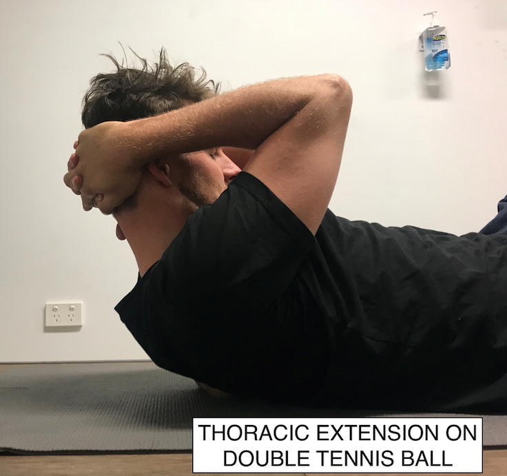 Thoracic Extension on Double Tennis Ball - Goal: Specific thoracic spine joint mobilityEquipment: Two tennis balls taped togetherKeep chin tucked on chest. Start with balls under the middle of the back, gently lean into them to reduce muscle tightness or extend over them gently to mobilise the joint. Spend 15 seconds on each spot or more if needed